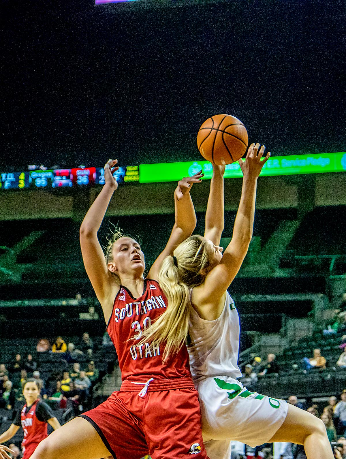 The Duck's Anneli Maley (#15) and the Thunderbird's Carlie Jones (#30) jump to try to catch a rebound. The University of Oregon Ducks women basketball team defeated the Southern Utah Thunderbirds 98-38 in Matthew Knight Arena Saturday afternoon. The Ducks had four players in double-digits: Ruthy Hebard with 13; Mallory McGwire with 10; Lexi Bando with 17 which included four three-pointers; and Sabrina Ionescu with 16 points. The Ducks overwhelmed the Thunderbirds, shooting 50% in field goals to South Utah's 26.8%, 53.8% in three-pointers to 12.5%, and 85.7% in free throws to 50%. The Ducks, with an overall record of 8-1, and coming into this game ranked 9th, will play their next home game against Ole Miss on December 17. Photo by August Frank, Oregon News Lab