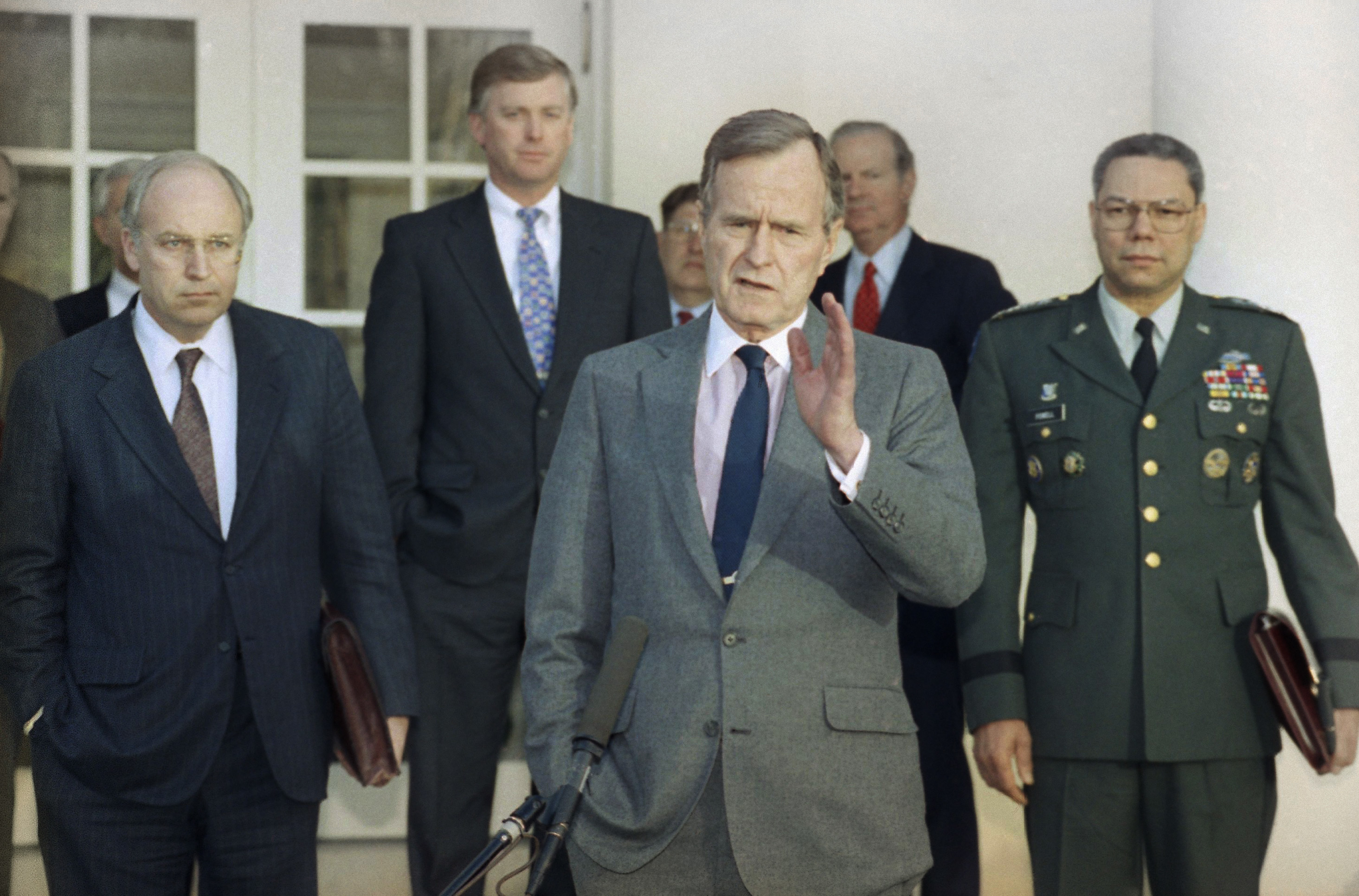 KVI's John Carlson recalls the highs and lows of the military and political career of America's 41st President, George Herbert Walker Bush who died Nov. 30, 2018 at age 94.{ } In this Feb. 11, 1991, file photo, President George H.W. Bush talks to reporters in the Rose Garden of the White House after meeting with top military advisors to discuss the Persian Gulf War. From left are, Defense Secretary Dick Cheney, Vice President Dan Quayle, White House Chief of Staff John Sununu, the president, Secretary of State James A. Baker III, and Joint Chiefs Chairman Gen. Colin Powell. Bush died about eight months after the death of his wife, Barbara Bush. (AP Photo/Ron Edmonds, File)