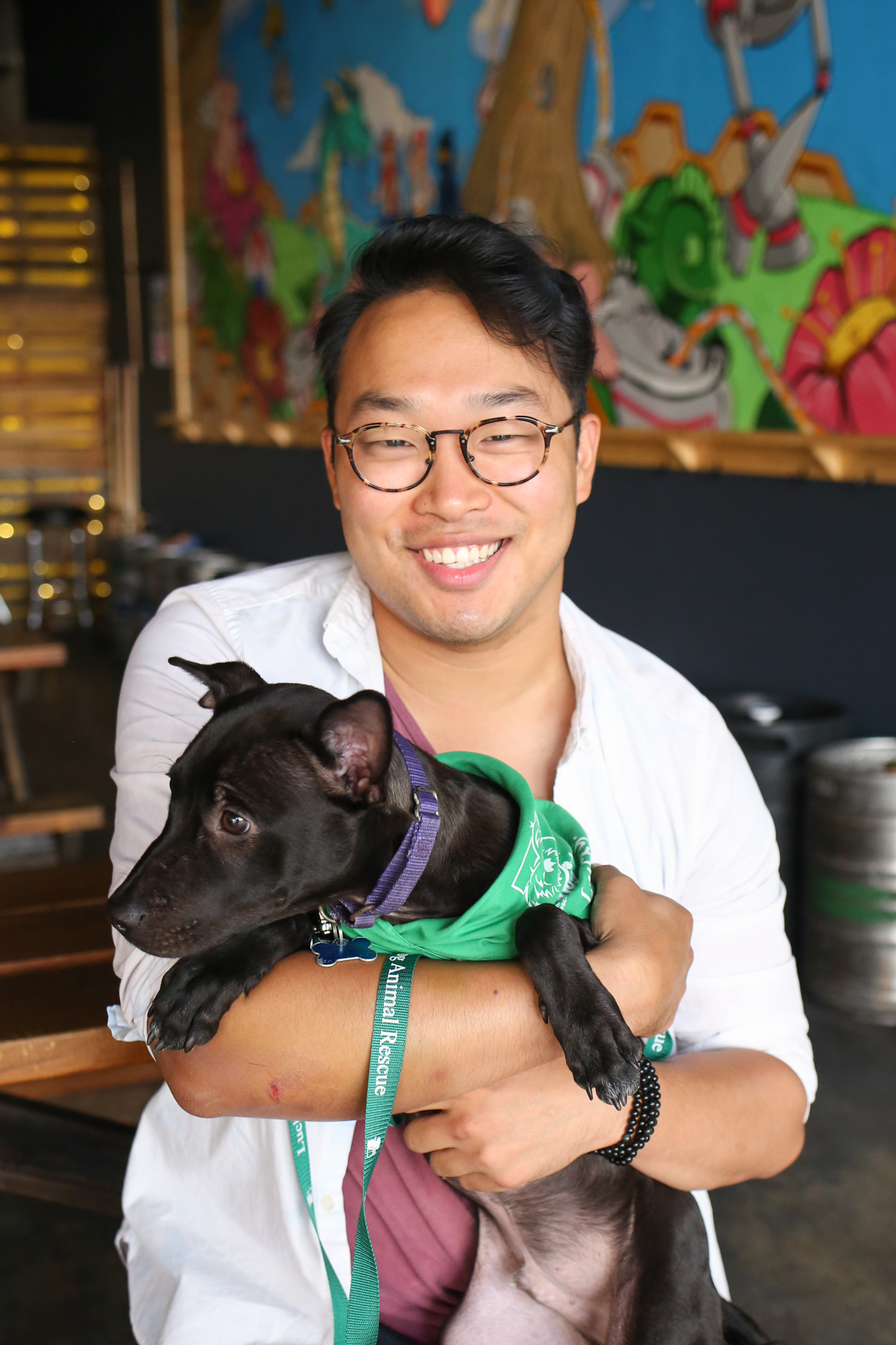 Meet Onyx and Luke, a 5-month-old Lab mix and a 28-year-old human respectively.{ }Photo location: Midlands Beer Garden (Image: Amanda Andrade-Rhoades/ DC Refined)