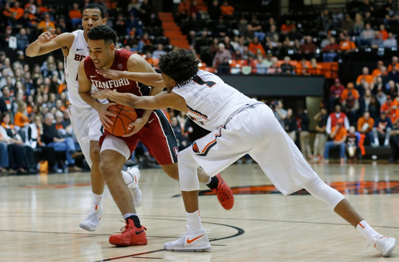 Stanford's Dorian Pickens, center, drives to the lane past Oregon State's Stephen Thompson Jr. (1) during the second half of an NCAA college basketball game in Corvallis, Ore., Thursday, Jan. 19, 2017. Stanford won 62-46. (AP Photo/Timothy J. Gonzalez)