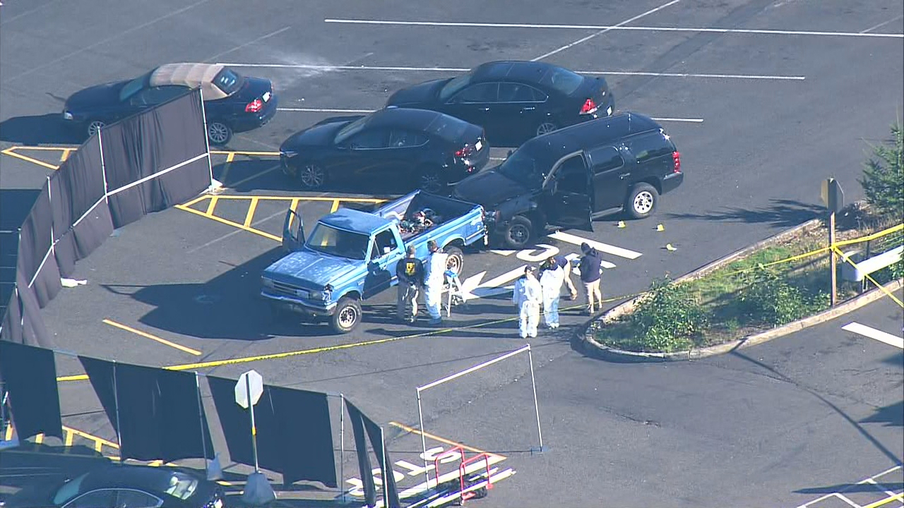 Puyallup tribal police and FBI agents investigate at the scene of the deadly shooting. (KOMO News/Air 4 photo)