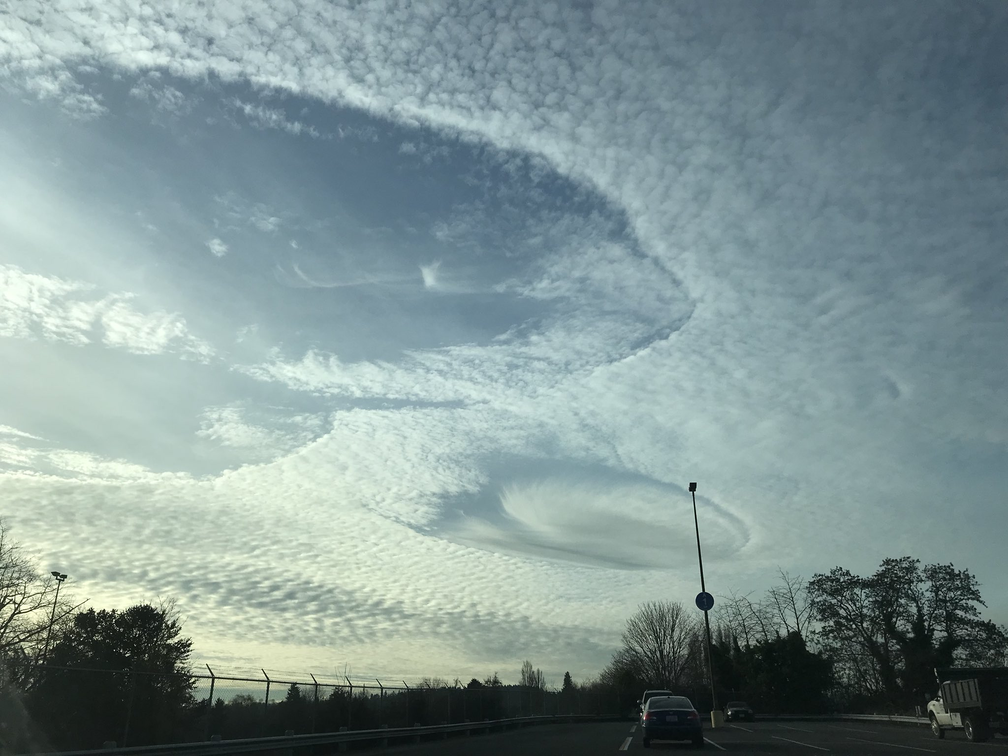 A Hole Punch cloud is spotted over Seattle on Dec. 13, 2017 (Photo: Lauri Richards)<p></p>