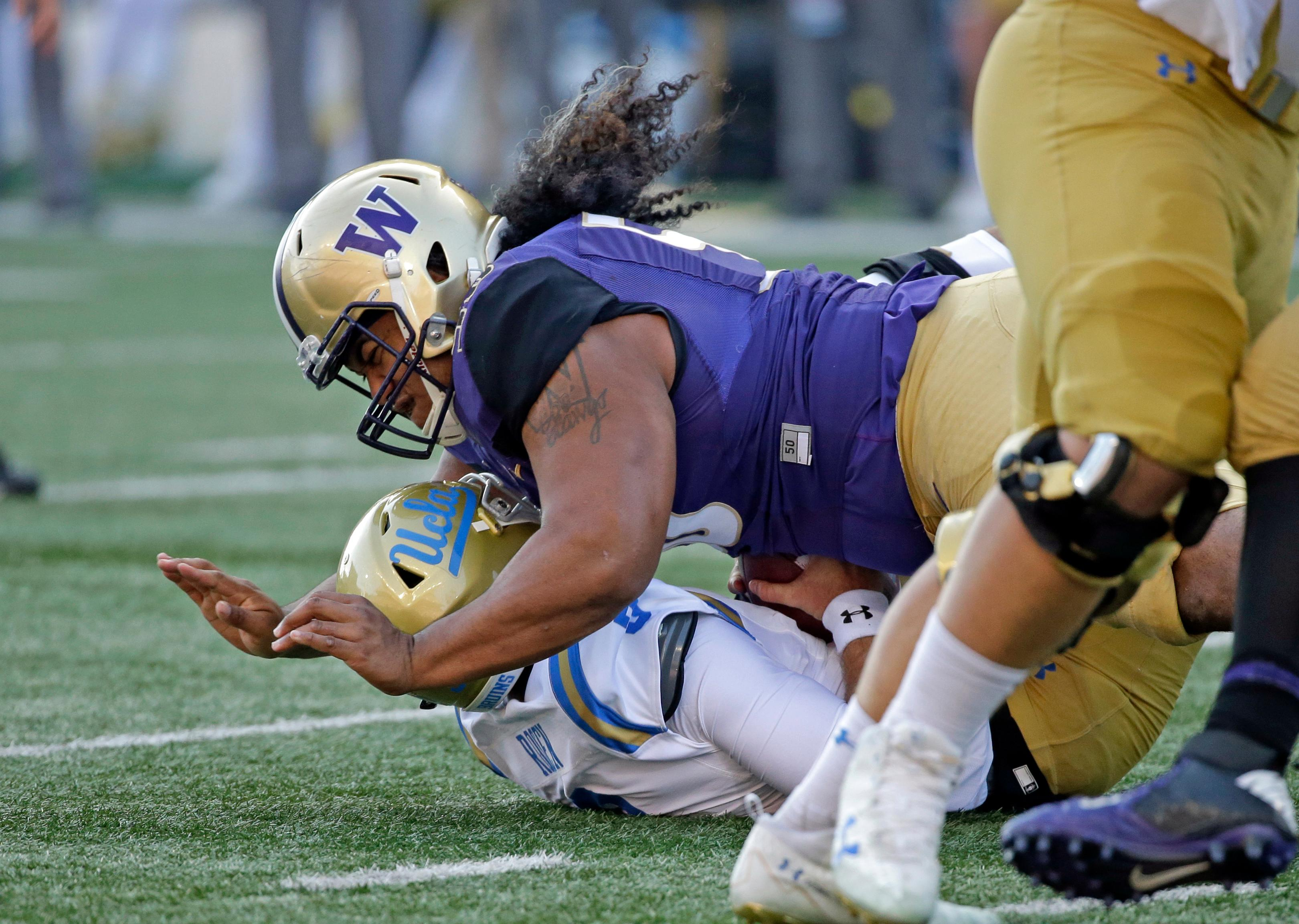 FILE - In this Oct. 28, 2017, file photo, Washington's Vita Vea sacks UCLA quarterback Josh Rosen in the first half of an NCAA college football game, in Seattle. Vea was selected to the AP All-Conference Pac-12 team announced Thursday, Dec. 7, 2017. (AP Photo/Elaine Thompson, File)