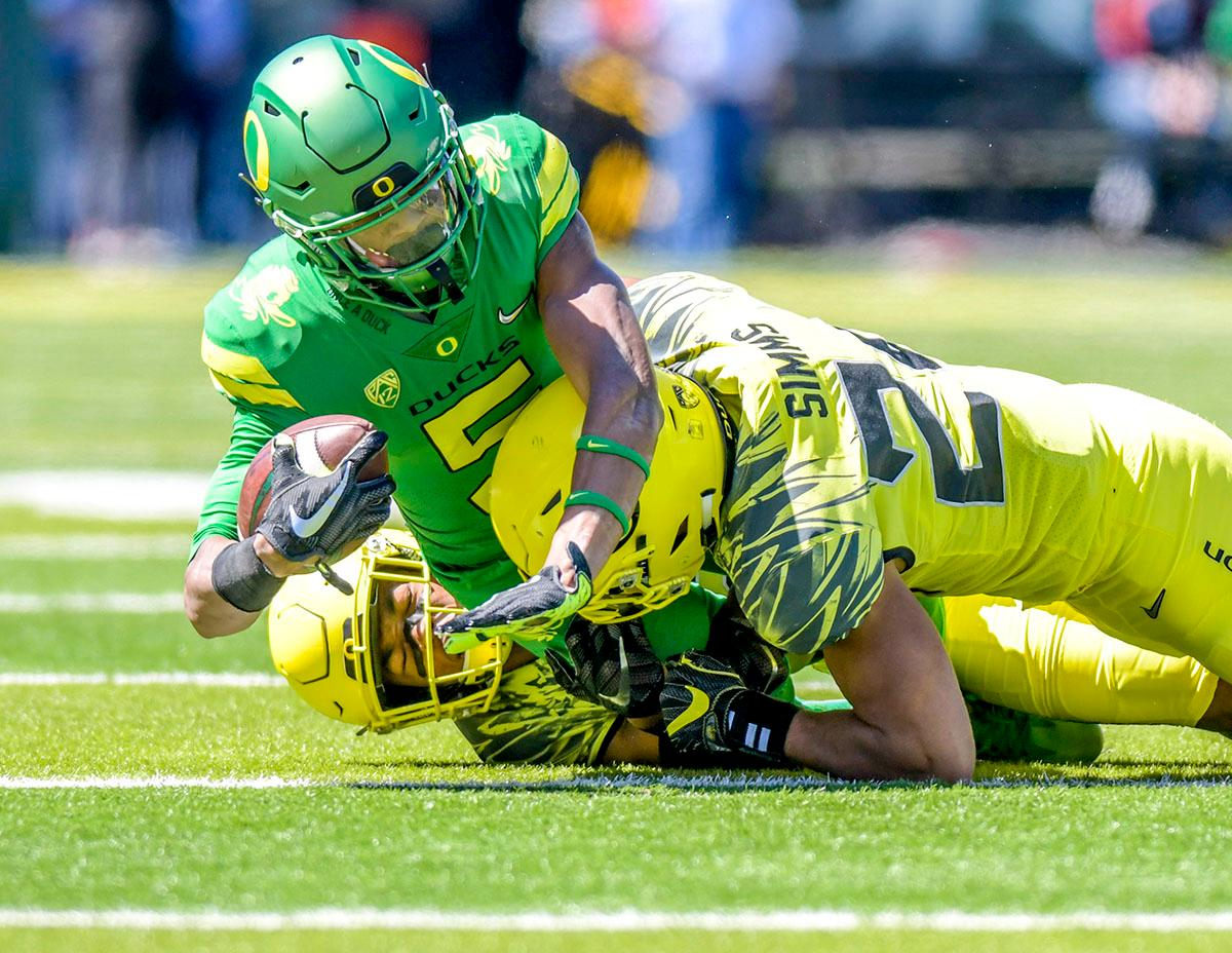 The Thunder's Taj Griffin (#5) is brought down during a run down the field. The Thunder defeated the Lightning 59-24 in the Spring Game on Saturday at Autzen Stadium. Photo by August Frank