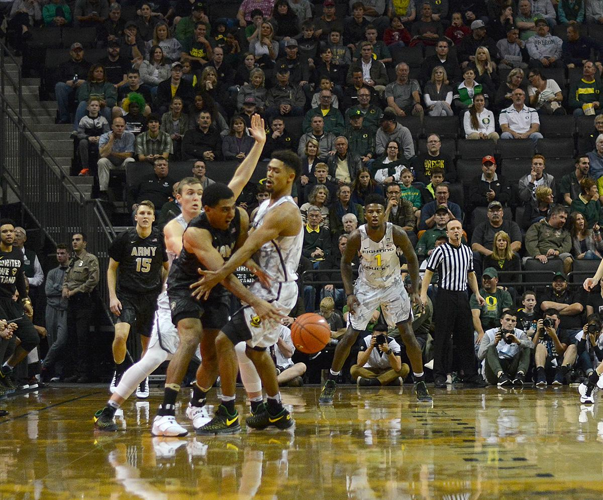 Ducks' Tyler Dorsey (#5) and Army's Kennedy Edwards (#10) battle for possession. In front of a sold out crowd, Oregon defeated Army 91-77 on opening night. Photo by Jacob Smith, Oregon News Lab