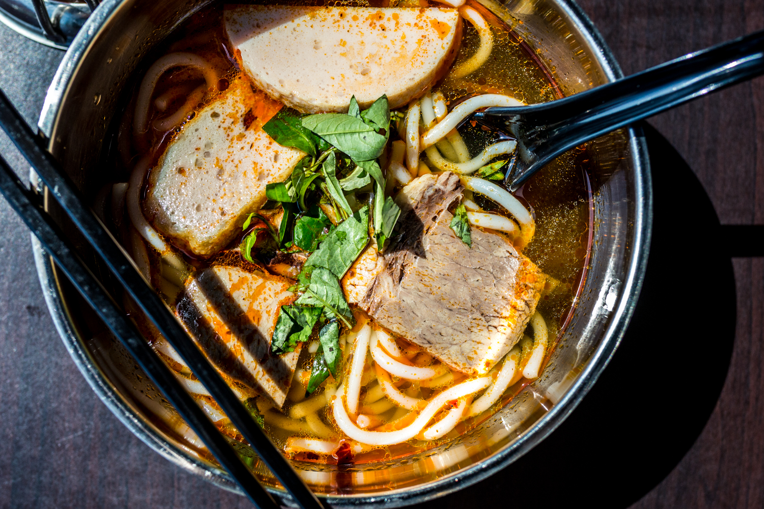 Spicy Beef Noodle Soup: rice noodles in a spicy lemongrass broth with beef slices, Vietnamese ham, soft tendon, cilantro, green onions, and white onions / Image: Catherine Viox // Published: 9.28.19
