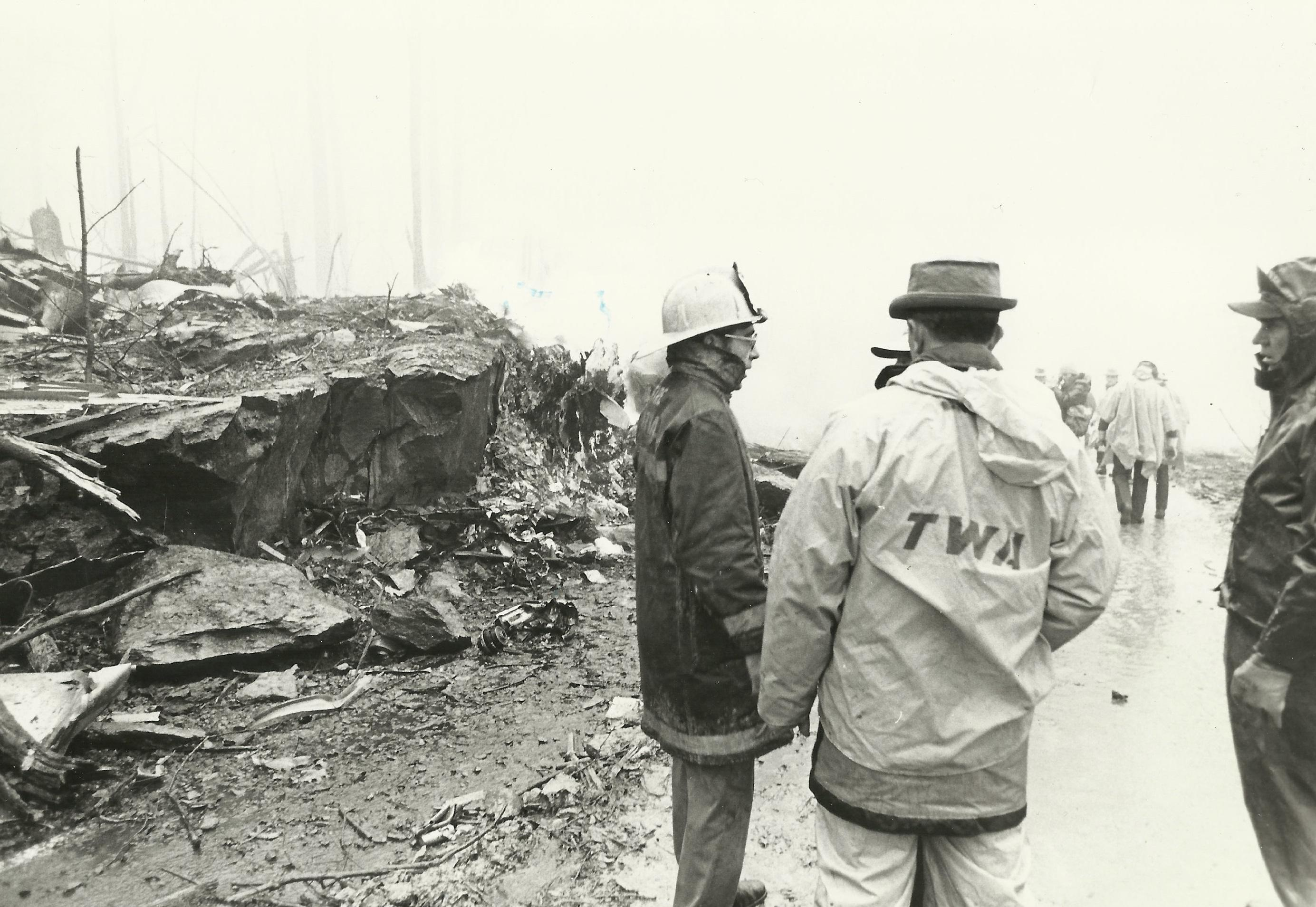Oliver Dube, Fire Marshal for Loudoun County, and a representative from TWA assess the damage on Mount Weather, December 1, 1974. (Photo courtesy of Oliver Dube)