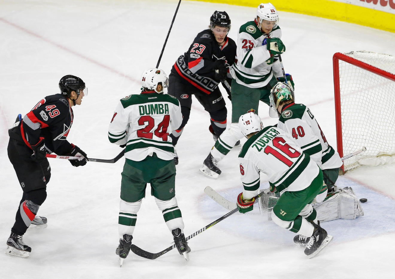 Carolina Hurricanes' Victor Rask (49), of Sweden, and Hurricanes' Brock McGinn (23) watch Rask's game winning shot on Minnesota Wild goalie Devan Dubnyk (40) as Wild's Matt Dumba (24), Jason Zucker (16) and Jonas Brodin (25), of Sweden, watch during the third period of an NHL hockey game in Raleigh, N.C., Thursday, March 16, 2017. Carolina won 3-1. (AP Photo/Gerry Broome)