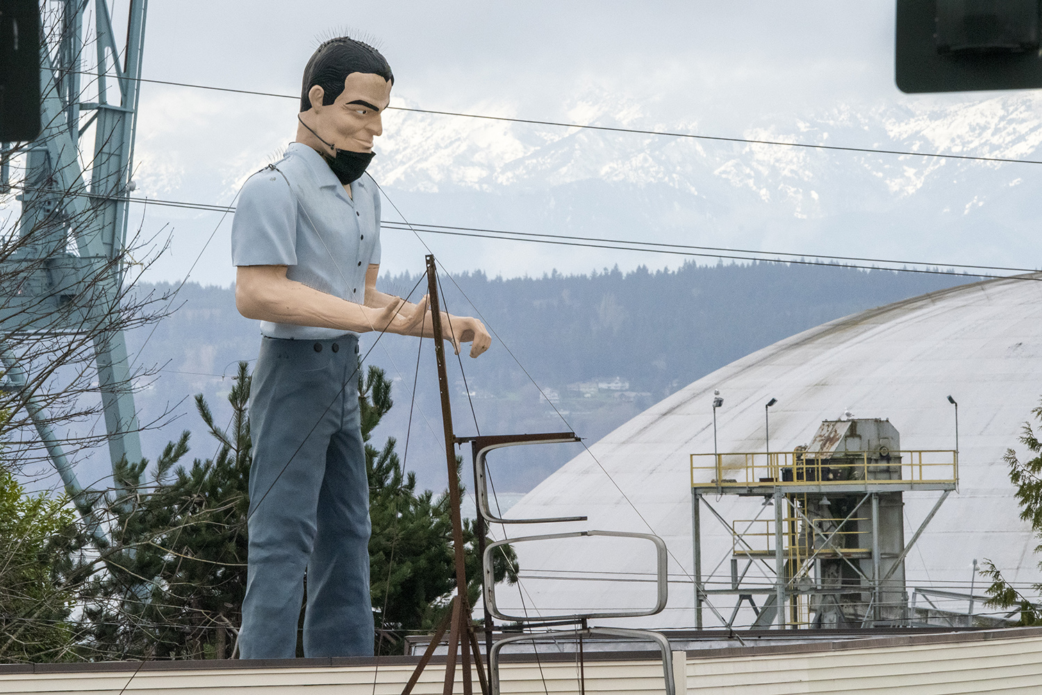 Everett's Muffler Man sports a denim look, jeans and a short-sleeved, button down shirt. Other Muffler Men across the country are outfitted with cowboy hats, crowns, space helmets and sombreros. (Rachael Jones / Seattle Refined)