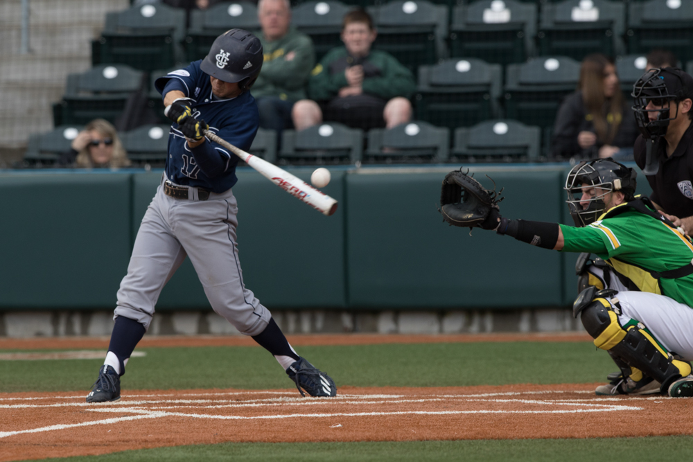 UC Irvine Anteaters outfielder Devin Pettengill (#17) fouls a ball. Oregon Ducks pitcher Matt Mercer (#11) throws a pitch.  In the second of the three game series, the Ducks beat the UC Irvine Anteaters 6-3. Photo by Austin Hicks, Oregon News Lab
