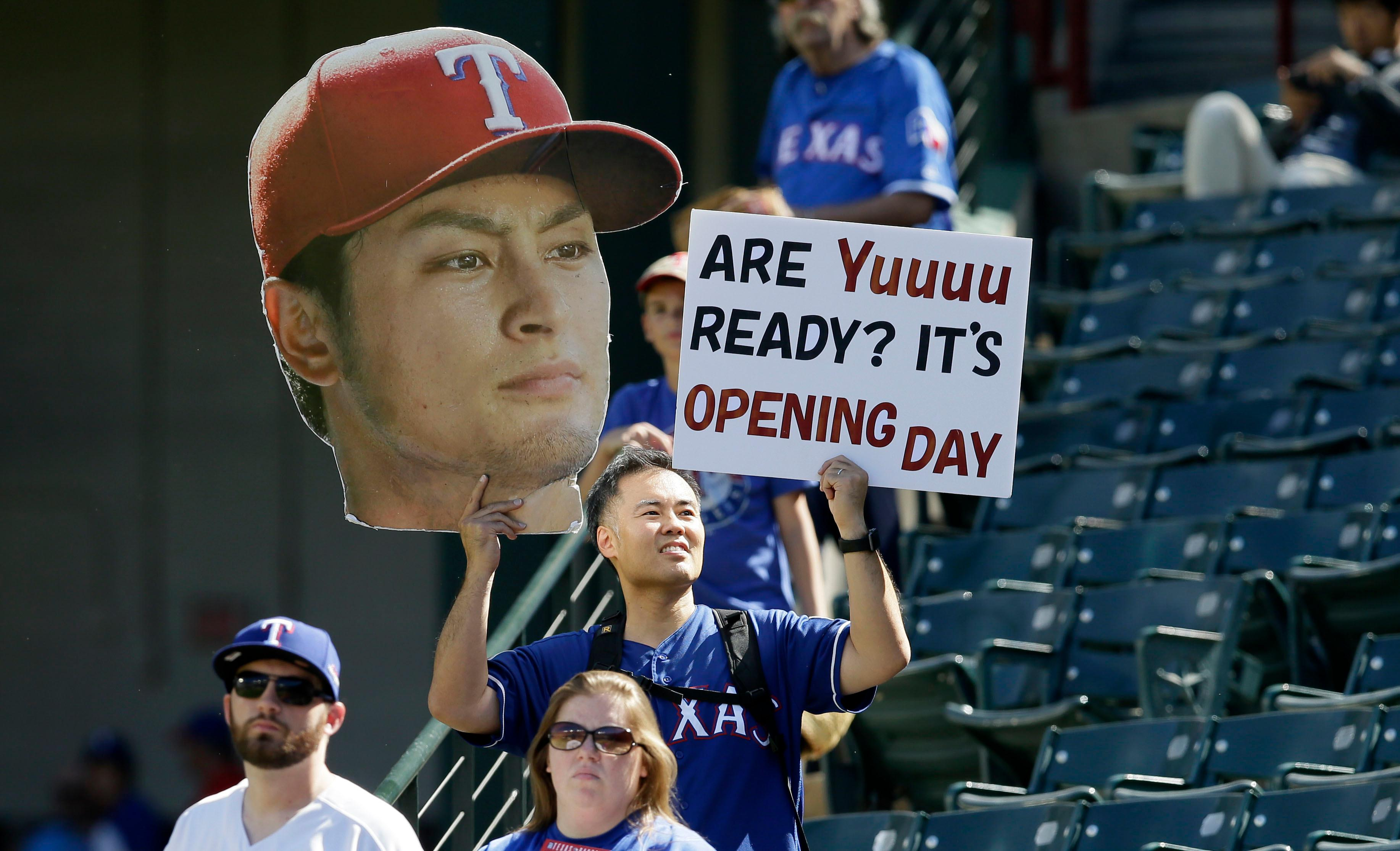 Color game ray otero - A Fan Holds Up A Sign And Photo Of Texas Rangers Starting Pitcher Yu Darvish Of