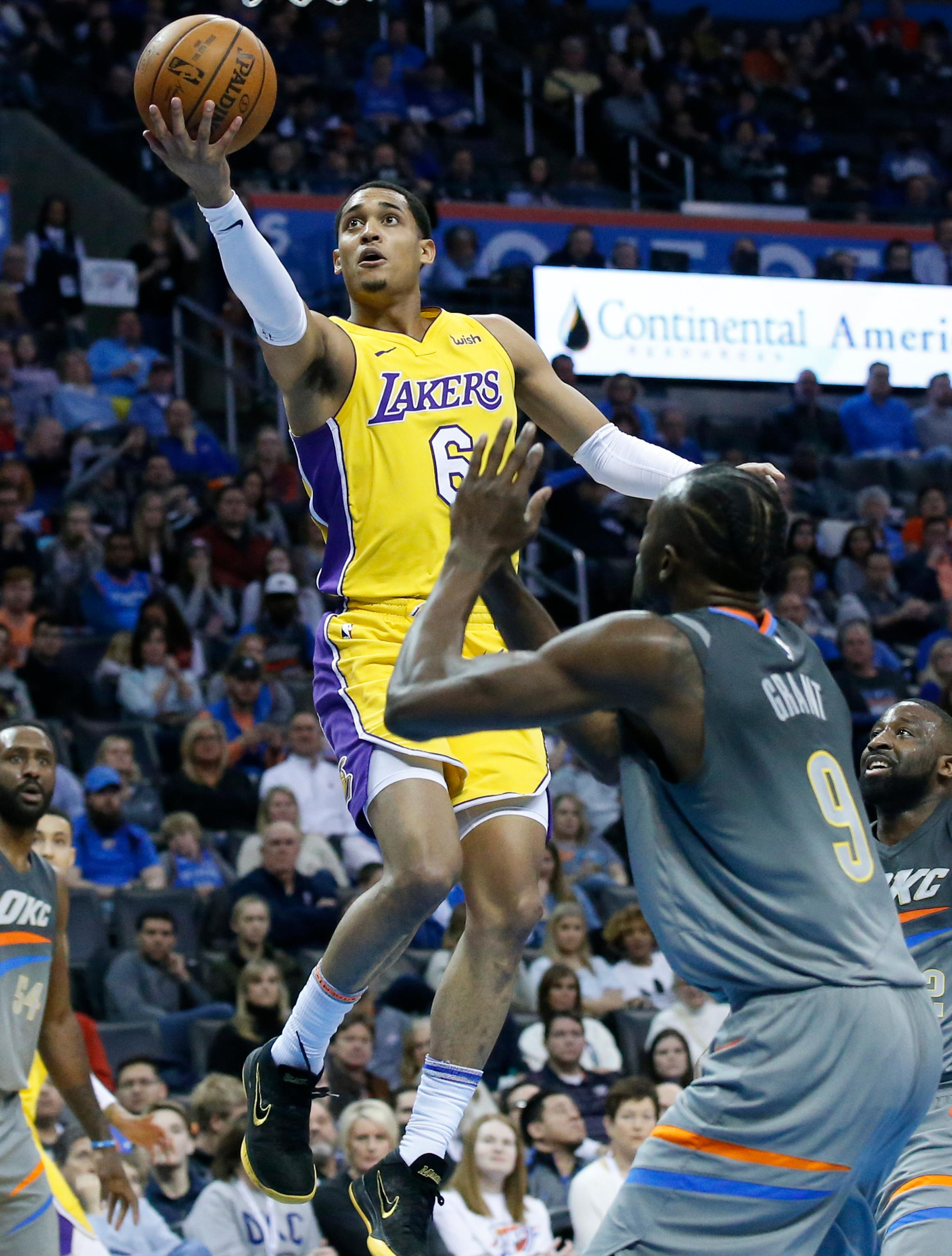 Los Angeles Lakers guard Jordan Clarkson (6) goes to the basket in front of Oklahoma City Thunder forward Jerami Grant (9) in the first half of an NBA basketball game in Oklahoma City, Sunday, Feb. 4, 2018. (AP Photo/Sue Ogrocki)