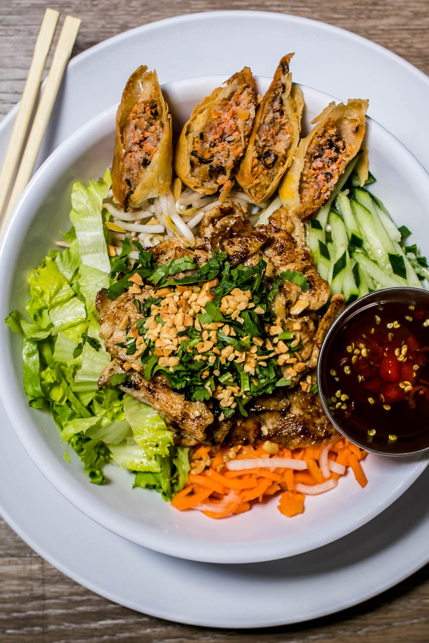 Bun Ga Nuong (Grilled Chicken Noodle Salad): Lemongrass grilled chicken, rice noodles, do chua, lettuce, bean sprouts, cucumber, mu hanh, cilantro, mint, Thai basil, crushed peanuts,  and nuoc mam pha (shown with cha gio) / Image: Amy Elisabeth Spasoff // Published: 3.2.18