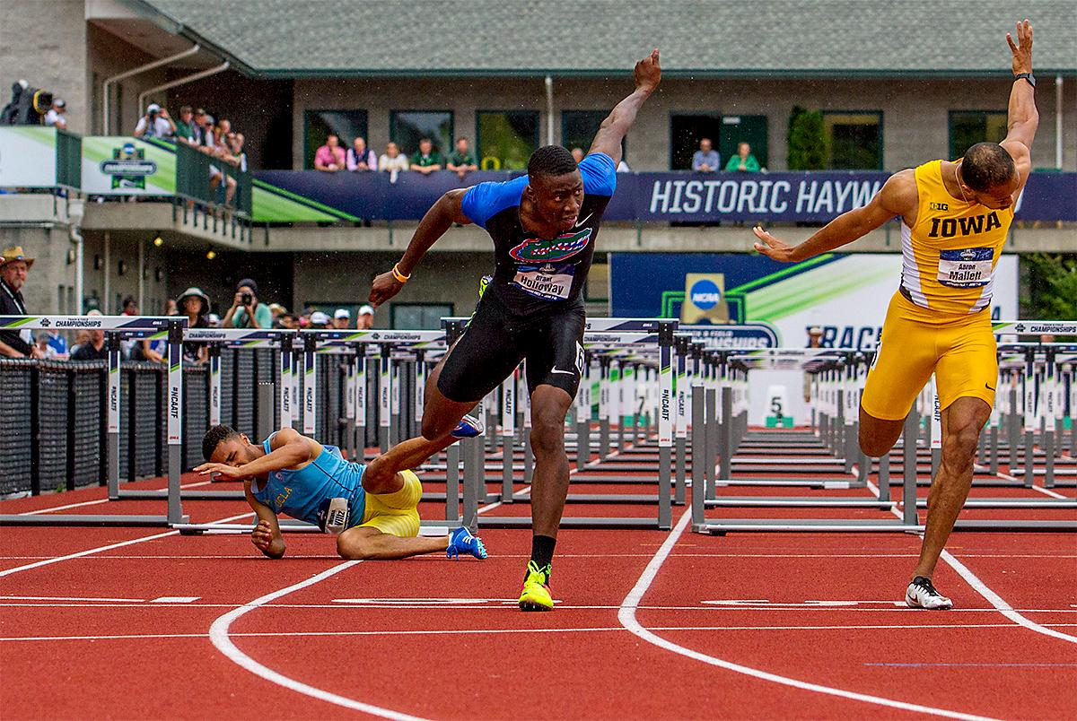 Florida's Grant Holloway (left) and Iowa's Aaron Mallett (right) hit the line in heat three of the 110 meter hurdles, placing first and second with a time of 13.41 and 13.44. Photo by August Frank, Oregon News Lab