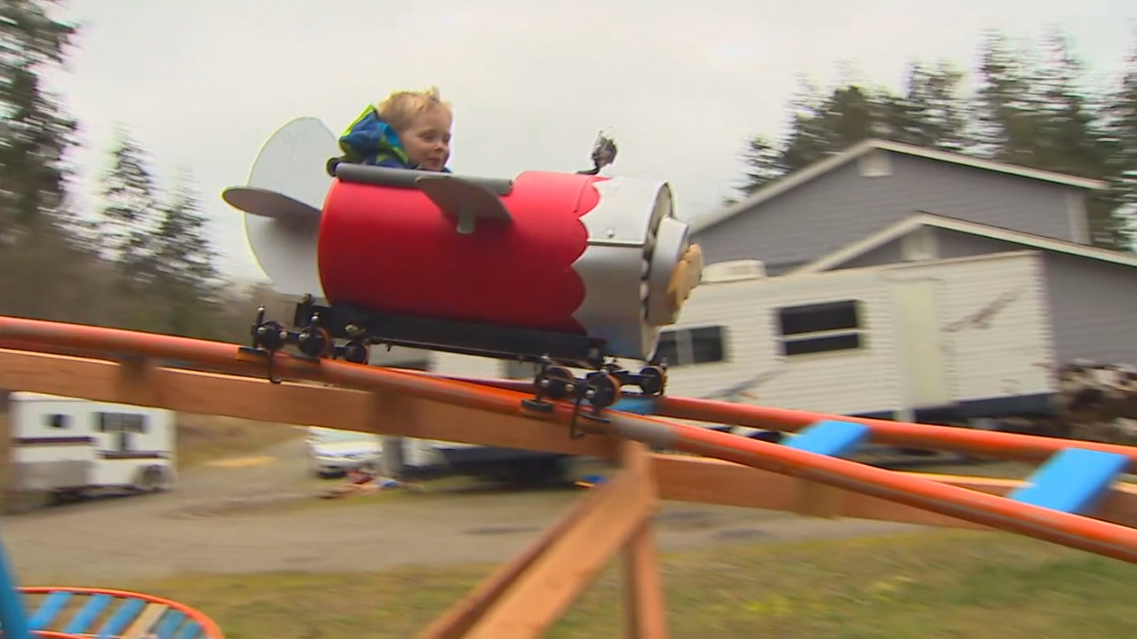 3-year-old Wyatt rides on a roller coaster his dad built in his Oak Harbor, Wash. backyard on March 2, 2017. (Photo: KOMO News)