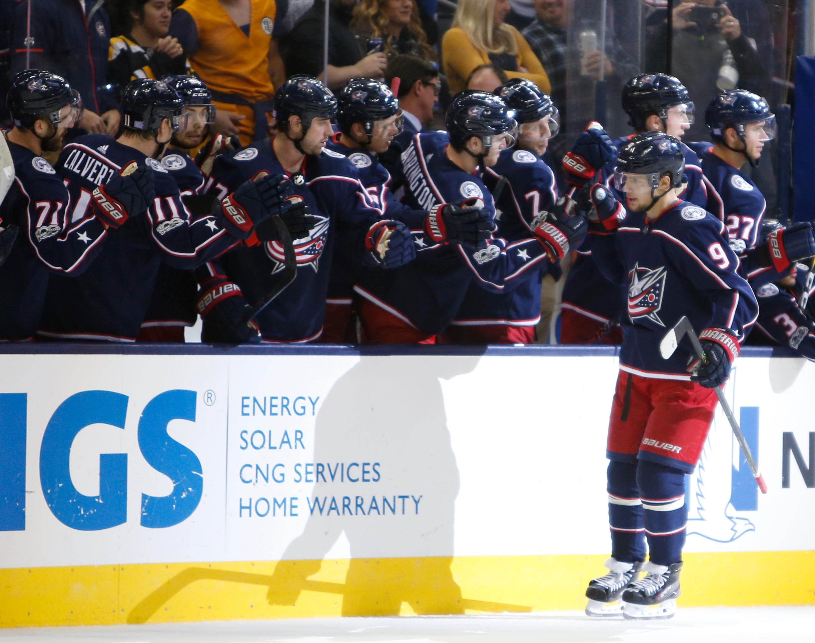 Columbus Blue Jackets' Artemi Panarin, right, of Russia, celebrates his goal against the Boston Bruins during the shootout period of an NHL hockey game Monday, Oct. 30, 2017, in Columbus, Ohio. The Blue Jackets beat the Bruins 4-3 in a shootout. (AP Photo/Jay LaPrete)