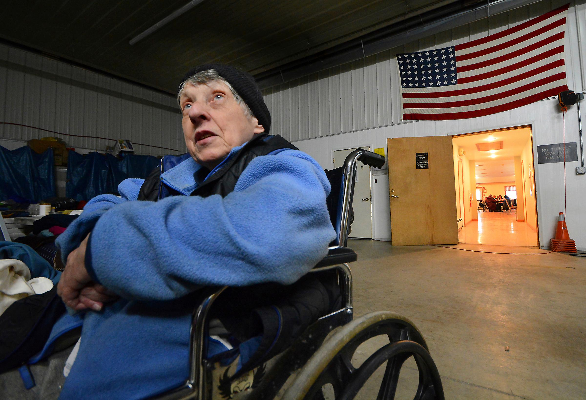 Morgan Sanders, 83, of Dingman Township, Pa., sits in the garage area of the Dingman Township Volunteer Fire Department on Wednesday, March 7, 2018. She and her cats have been staying at the make-shift shelter for several days due to no power at her home. (Butch Comegys/The Scranton Times-Tribune via AP)