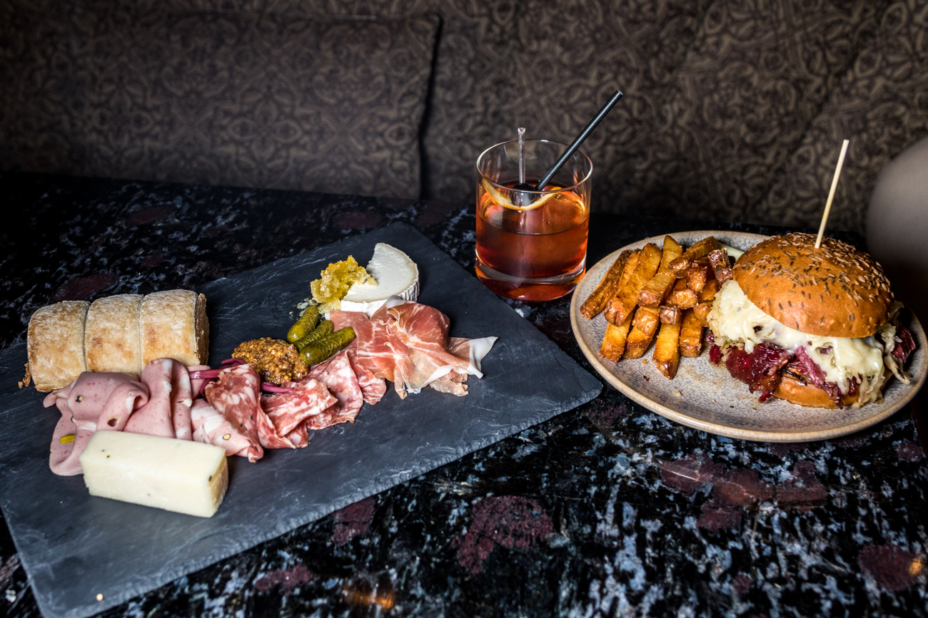 Charcuterie board, Chef's Old Fashioned, and Pastrami Reuben from The Bar at Palm Court / Image: Catherine Viox // Published: 9.8.20