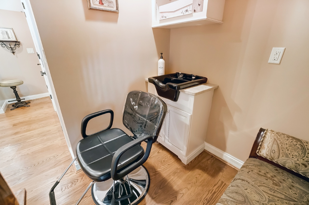 <p>We weren't kidding—behold, your very own in-home salon! / Image courtesy of Wow Video Tours via Michael Franz of Coldwell Banker West Shell-Hyde Park // Published: 9.7.20</p>