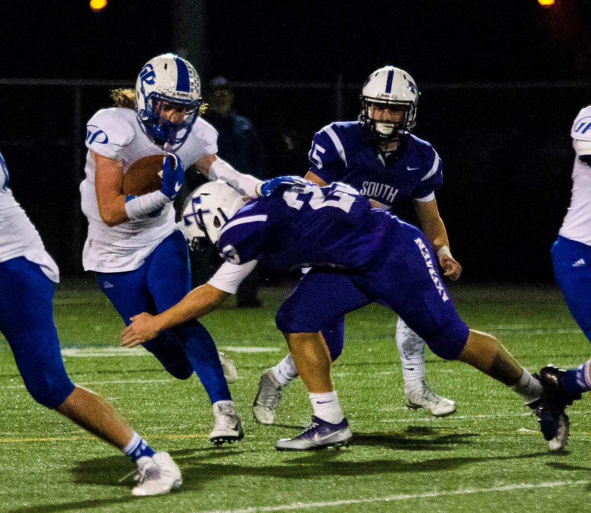 Grants Pass Cavemen Jerin Appling (#10) breaks a tackle to gain yards. Grants Pass Cavemen defeated South Eugene Axemen 13-6 on Friday night at South Eugene. Photo by Jonathan Booker, Oregon News Lab