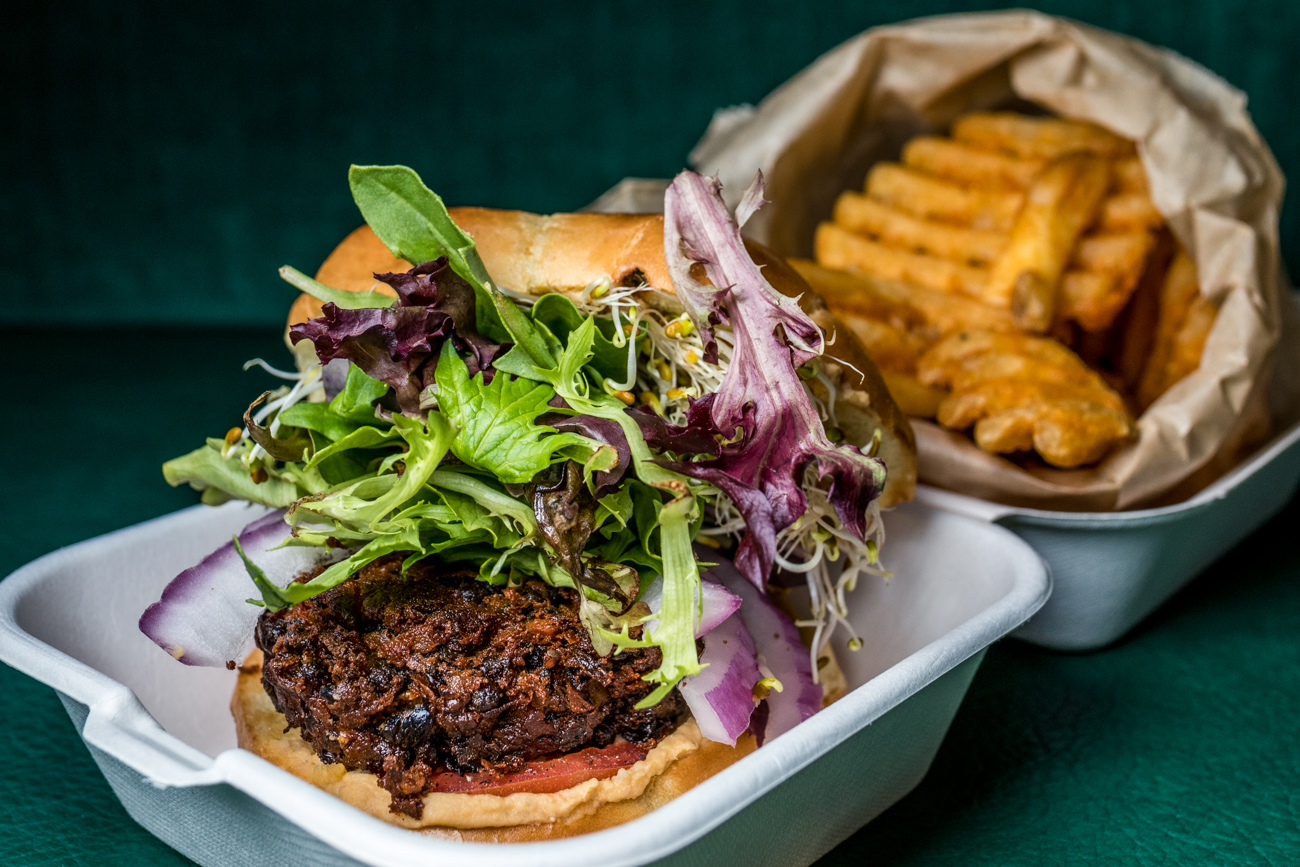 Veggie Burger: lentil, garbanzo and black bean burger topped with hummus, tomato, sprouts, and onion on a brioche bun served with a side of fries / Image: Catherine Viox  // Published: 6.1.20