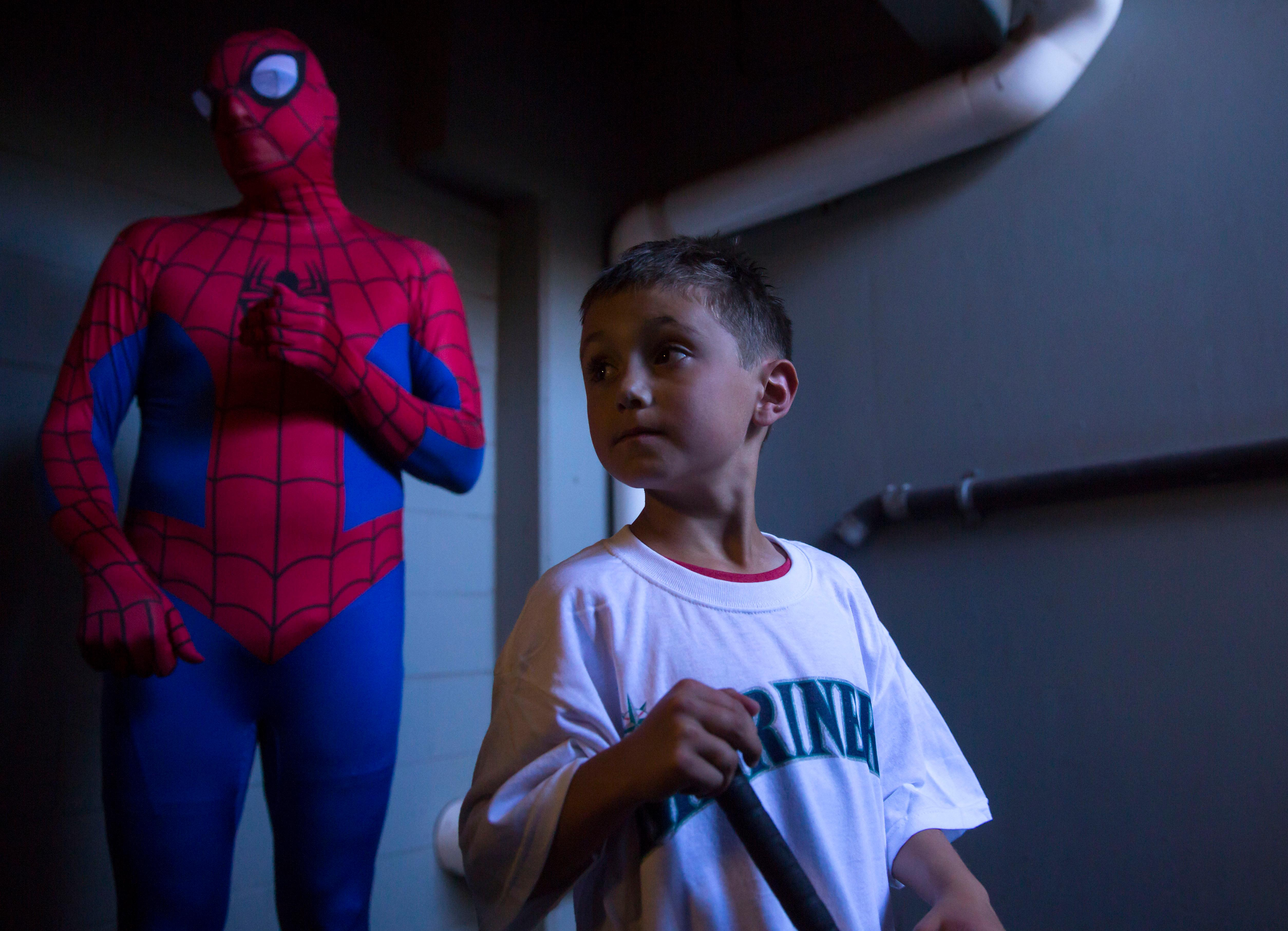 "Mason Nettleton was diagnosed with kidney cancer at age four, he bravely adopted a superhero attitude, often dressing as Spider-Man or Captain America, and teamed up with superheroes at Seattle Children's Hospital in his battle to beat the disease. After a surgery and chemotherapy, Mason valiantly beat his cancer by the age of six. Now age seven, Mason was selected to serve Seattle as ""Superhero for a Day"" on Tuesday, June 27, in conjunction with a special premier of the new Spider-Man: Homecoming movie. The Nettleton family was treated out with a stay at the Four Seasons Hotel, Mocktail happy hour in Spider-Man suits with chef Ethan Stowell at Goldfinch Tavern, a visit to the Space Needle observation deck, and a Seattle Mariners on-field visit to batting practice before the Mariners host Philadelphia. (Sy Bean / Seattle Refined)"