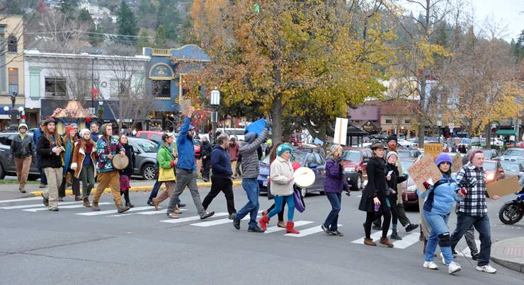 A crowd descends on Wells Fargo Bank in Ashland for a second day of protesting and to cancel accounts for the bank's corporate funding of the Dakota Access Pipeline - Denise Baratta