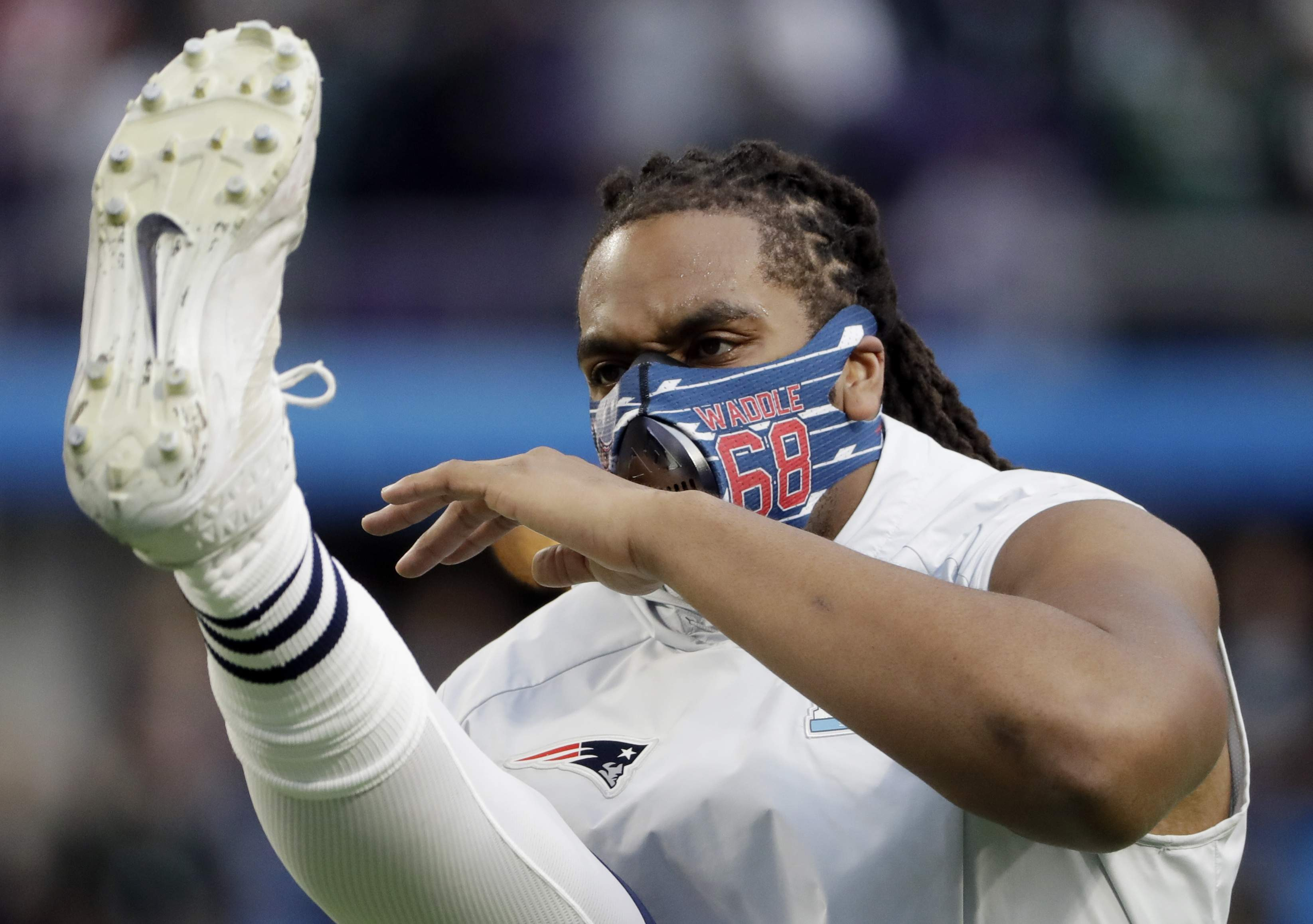 New England Patriots offensive tackle LaAdrian Waddle, warms up before the NFL Super Bowl 52 football game against the Philadelphia Eagles, Sunday, Feb. 4, 2018, in Minneapolis. (AP Photo/Chris O'Meara)