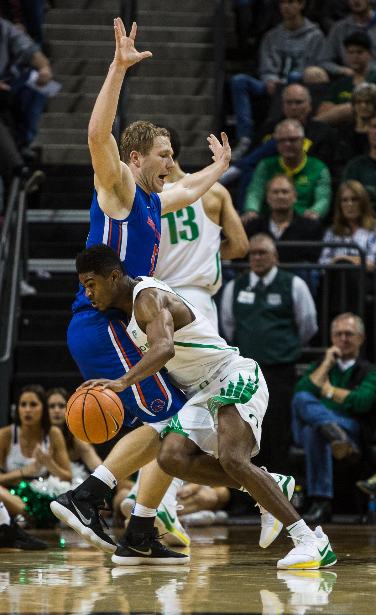 University of Oregon Duck Victor Bailey Jr. (#10) tries to break past Boise State Bronco Chris Sengfelder (#43). The Boise State Broncos defeated the University of Oregon Ducks 73 – 70 at Matthew Knight Arena in Eugene, Ore., on December 1, 2017. Photo by Kit MacAvoy, Oregon News Lab