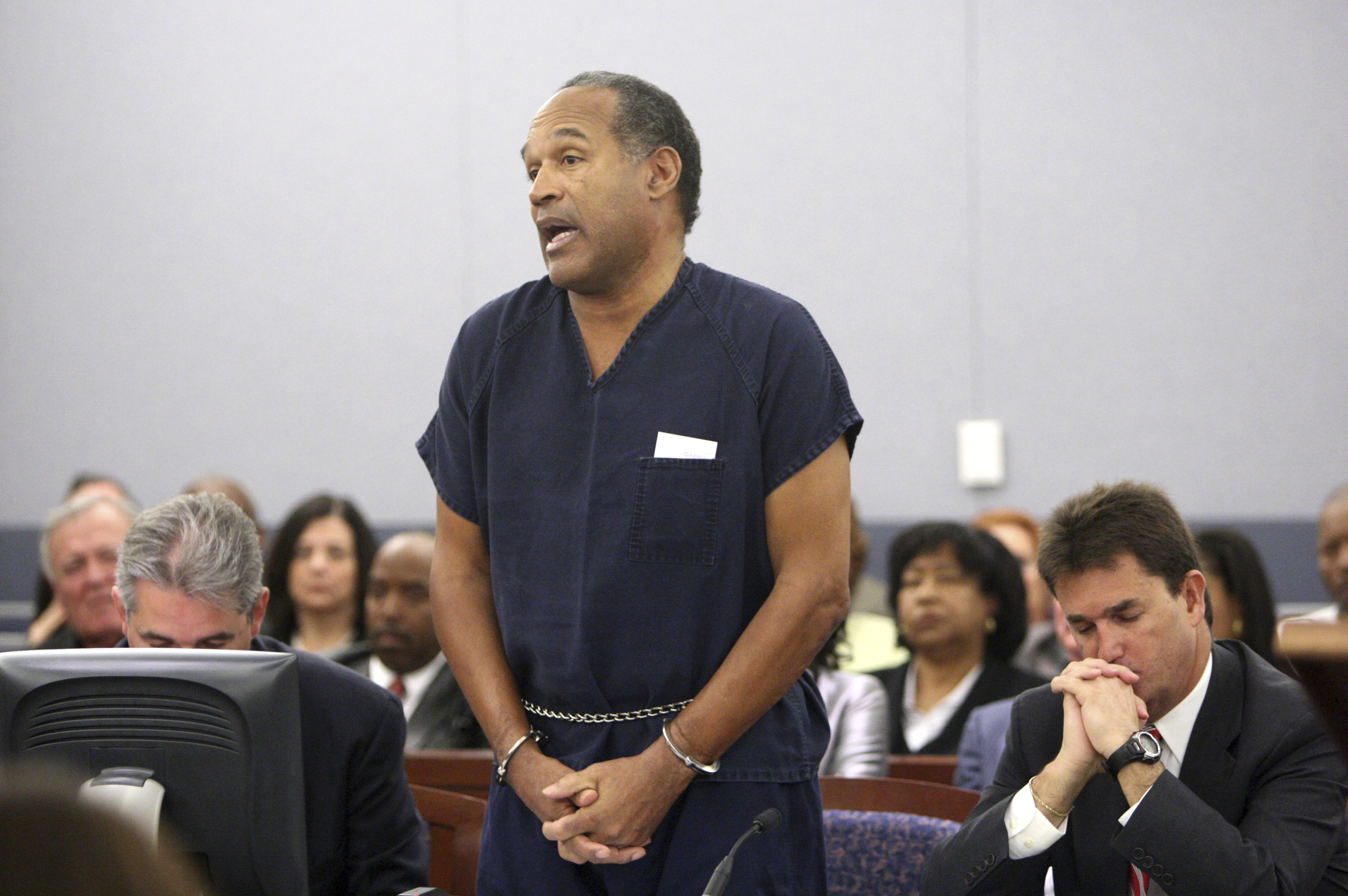 "FILE - In this Dec. 5, 2008, file photo, O.J. Simpson speaks during his sentencing hearing at the Clark County Regional Justice Center in Las Vegas. Sitting right to Simpson is his lawyer Yale Galanter. Simpson was sentenced Friday to at least 15 years in prison for a hotel armed robbery after a judge rejected his apology and said, ""It was much more than stupidity."" A Nevada prison official said early Sunday, Oct. 1, 2017, O.J. Simpson, the former football legend and Hollywood star, has been released from a Nevada prison in Lovelock after serving nine years for armed robbery.  (AP Photo/Isaac Brekken, Pool, File)"