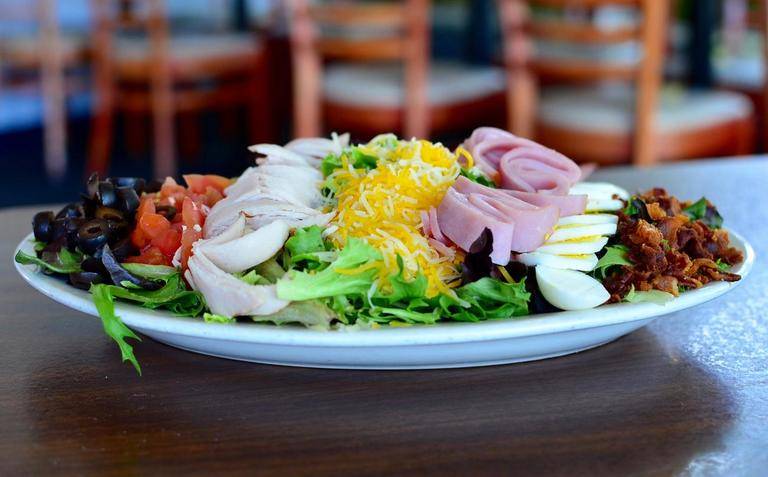 The Cobb Salad: crisp greens topped with rows of jack & cheddar cheeses, turkey breast, diced tomato, honey jam, boiled egg, black olives & bacon / Image: Leah Zipperstein, Cincinnati Refined // Published: 6.21.17