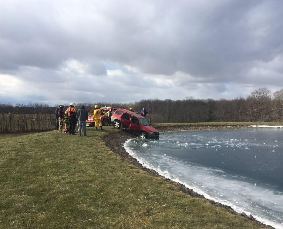 Rescue crews had to pull out this red SUV from a pond in Dimock Wednesday morning.<p></p>