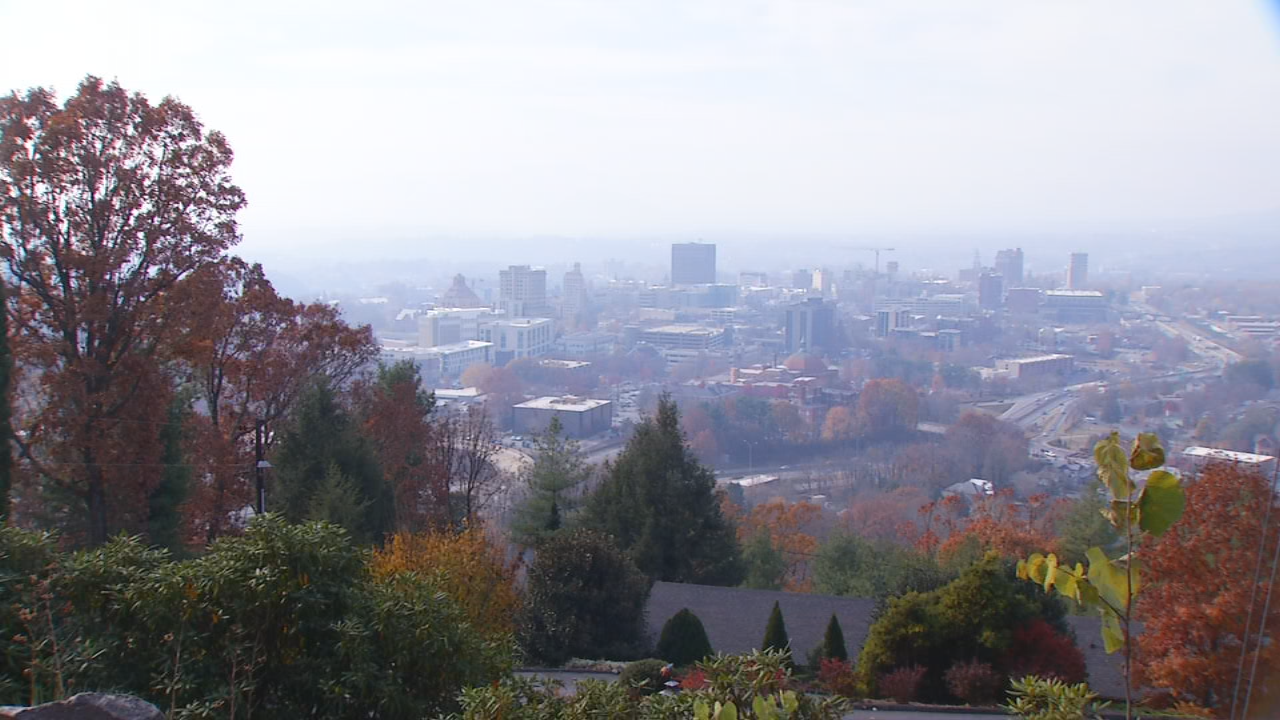 Asheville on Nov. 23, 2016, as wildfire smoke blankets the region. Another day of Code Red air quality conditions caused health concerns across the mountains as crews try to get a handle on wildfires. (Photo credit: WLOS staff)