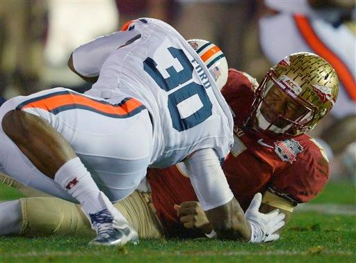 Auburn's Dee Ford sacks Florida State's Jameis Winston during the first half of the NCAA BCS National Championship college football game Monday, Jan. 6, 2014, in Pasadena, Calif.