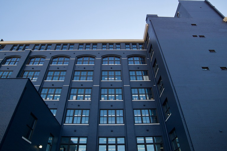 The 7-story building at 1100 Sycamore Street, originally the Sun Furniture Building, was designed by famed Cincinnati architect Samuel Hannaford and constructed in 1900. Its renovated 64,000-square-feet of office space feature hardwood floors, exposed brick, beams, ductwork, and plenty of collaborative space. The building's office tenants include Architects Plus, one of the largest architecture firms in the city, and Alchemy, a digital innovations lab. For leasing info contact Levine Properties, LLC, at 513.241.6748. ADDRESS: 1100 Sycamore Street (45202) / Image: Brian Planalp // Published: 3.20.18
