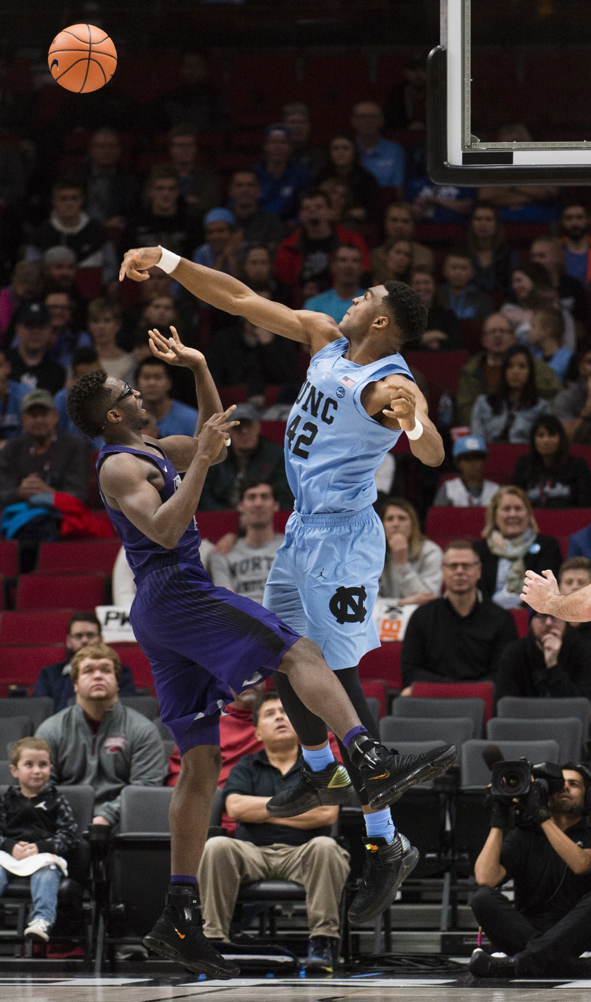 North Carolina forward Brandon Huffman, right, blocks a shot by Portland forward Tahirou Diabate, left, during the first half in an NCAA college basketball game at the Phil Knight Invitation Tournament, in Portland, Ore., Thursday, Nov. 23, 2017. (AP Photo/Troy Wayrynen)
