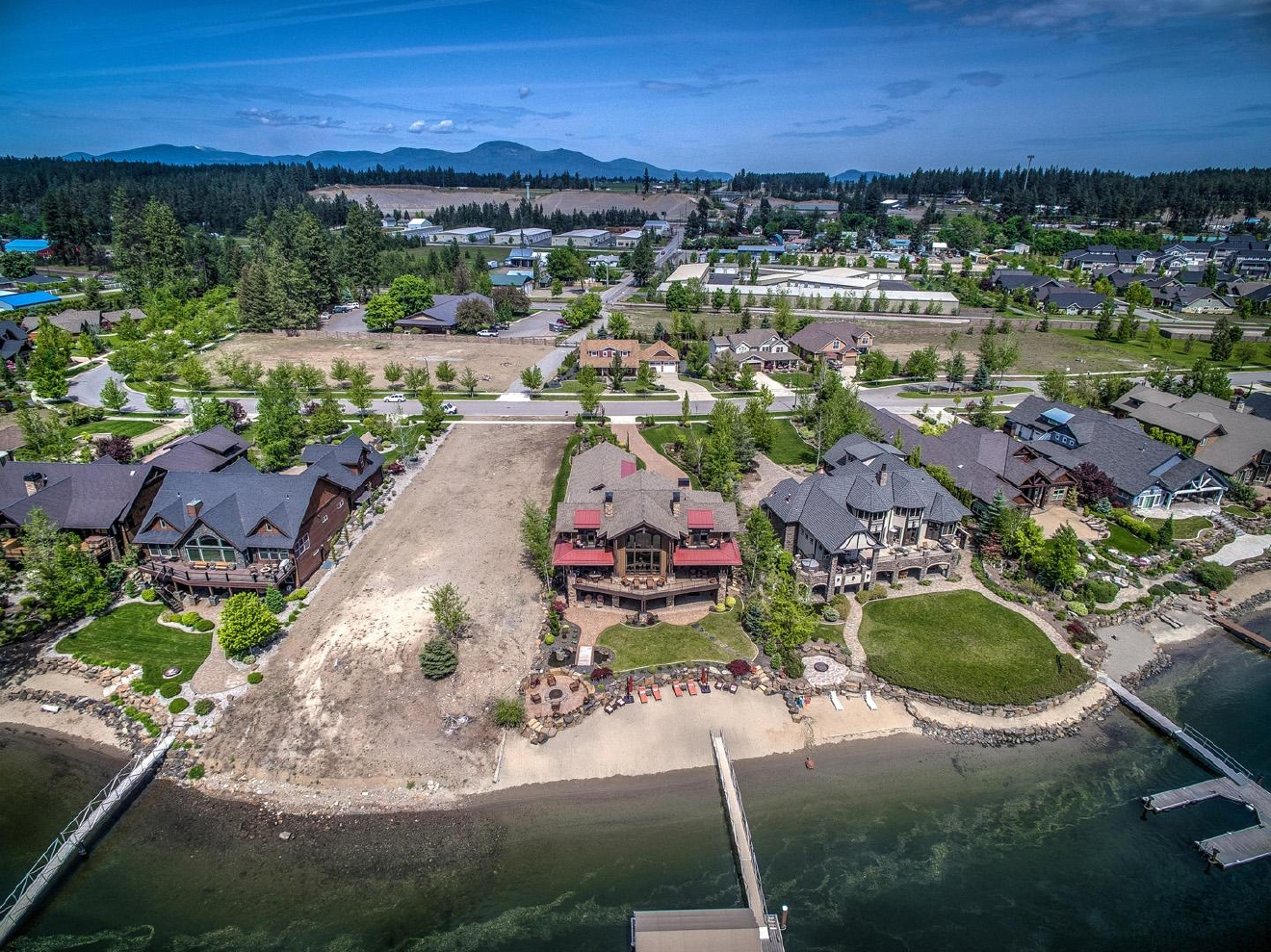 Undeniably one of the nicest homes on the Spokane River/Cda Lake!! With 5 elegant bedrooms, 5.5 baths and an elevator for convenience, this 6,651 SF home on 91 feet of sandy beach frontage will not disappoint. Featured in several magazines, this daylight walkout retreat is loaded with the highest quality appointments of the upmost quality. The floor plan includes a chef's kitchen, butler's pantry, a wet bar to be envious of and a uniquely designed wine cellar. The theater room is equipped perfectly for viewing pleasures to be envious of. Professionally decorated and architecturally designed including the front and rear water features and firepit. Deep water frontage keeps you boating longer and the spacious 4 car garage provides ample protected parking. | Information: 208-640-8086 tomtorg@roadrunner.com
