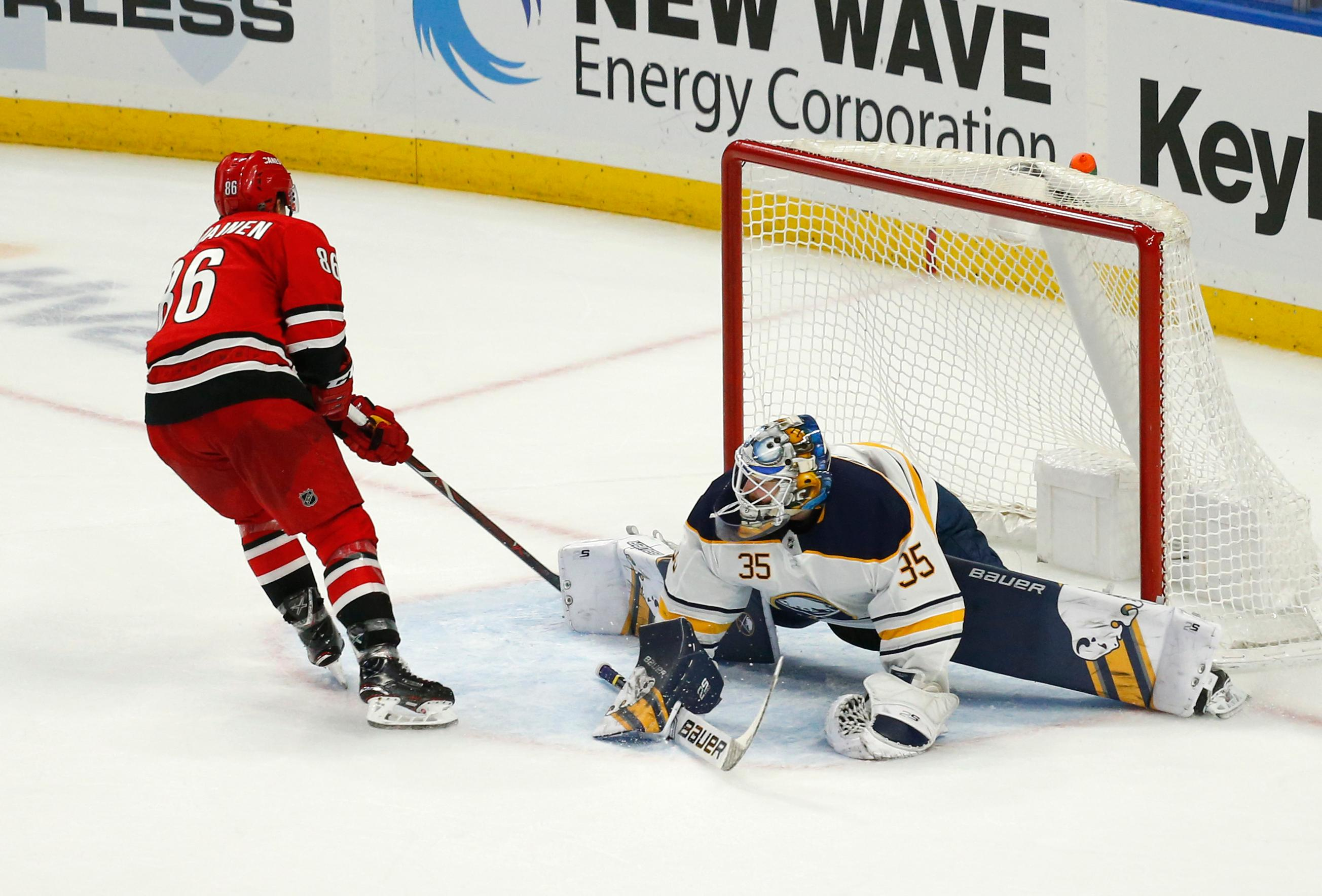 Carolina Hurricanes forward Teuvo Teravainen (86) puts the puck past Buffalo Sabres goalie Linus Ullmark (35) for a goal during overtime in an NHL hockey game, Thursday, Feb. 7, 2019, in Buffalo, N.Y. (AP Photo/Jeffrey T. Barnes)