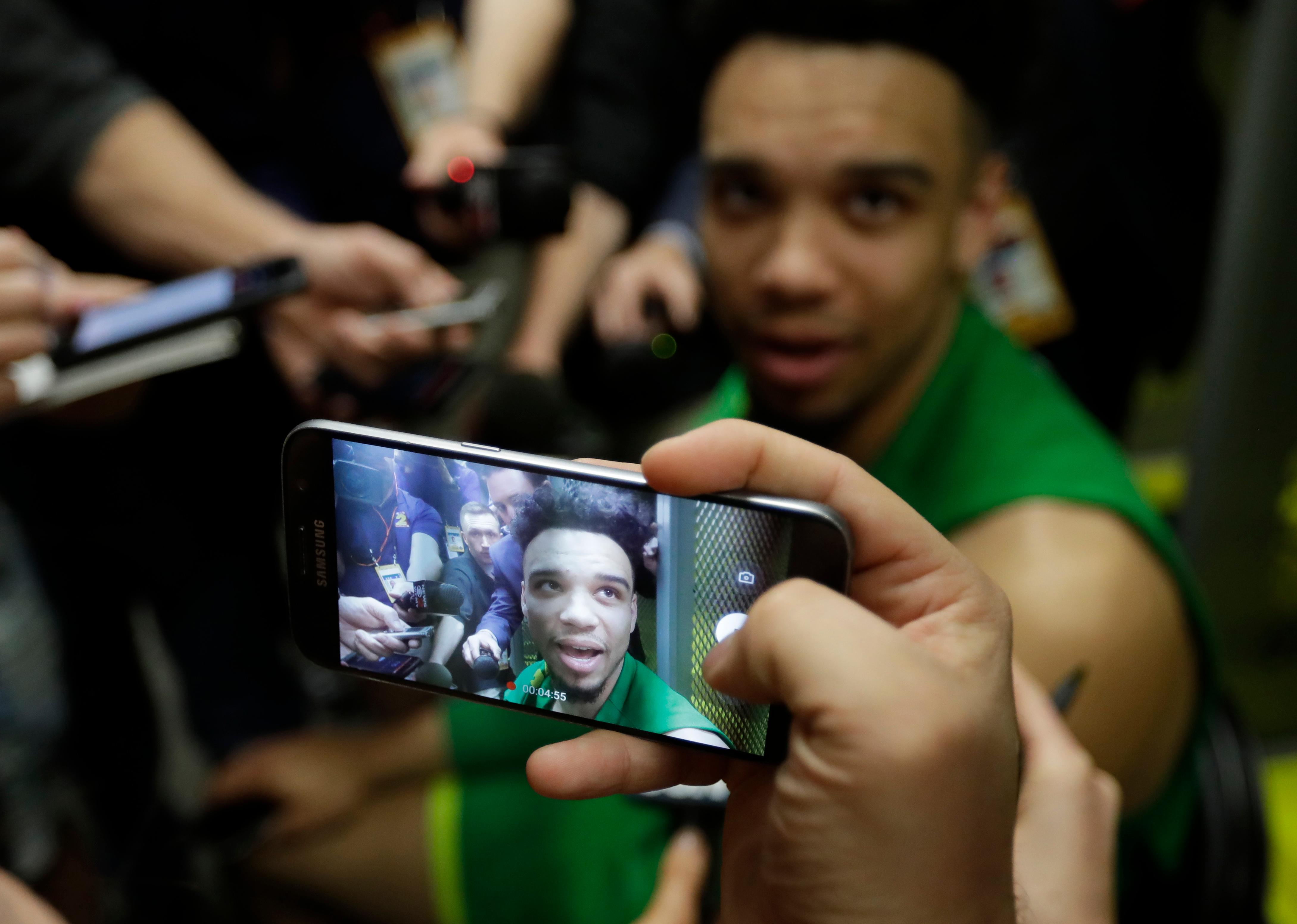 Oregon's Dillon Brooks answers questions after a practice session for their NCAA Final Four tournament college basketball semifinal game Thursday, March 30, 2017, in Glendale, Ariz. (AP Photo/David J. Phillip)