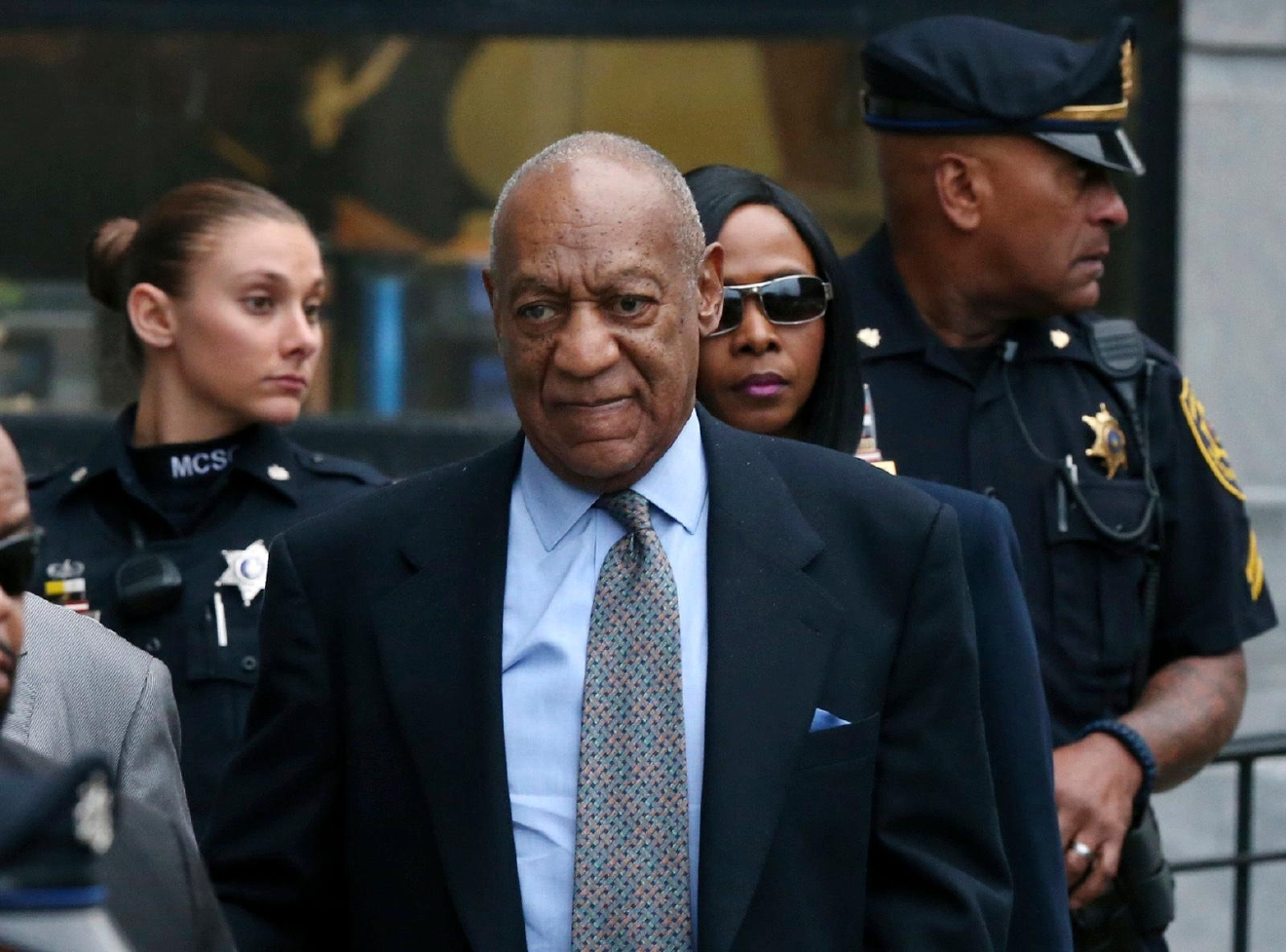 FILE - In this Nov. 1, 2016 file photo, Bill Cosby leaves after a hearing in his sexual assault case at the Montgomery County Courthouse in Norristown, Pa. Lawyers for Cosby will battle in court starting Tuesday, Dec. 13, to try to limit the number of other accusers who can testify at the comedian's sexual assault trial. (AP Photo/Mel Evans, File)