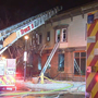 5 people escape morning fire; 2 dogs die