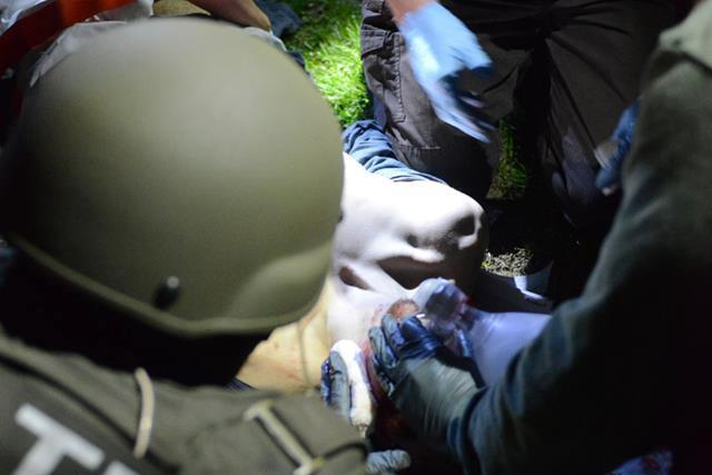Medical personnel work on Tsarnaev after he is pulled from the boat by policed.