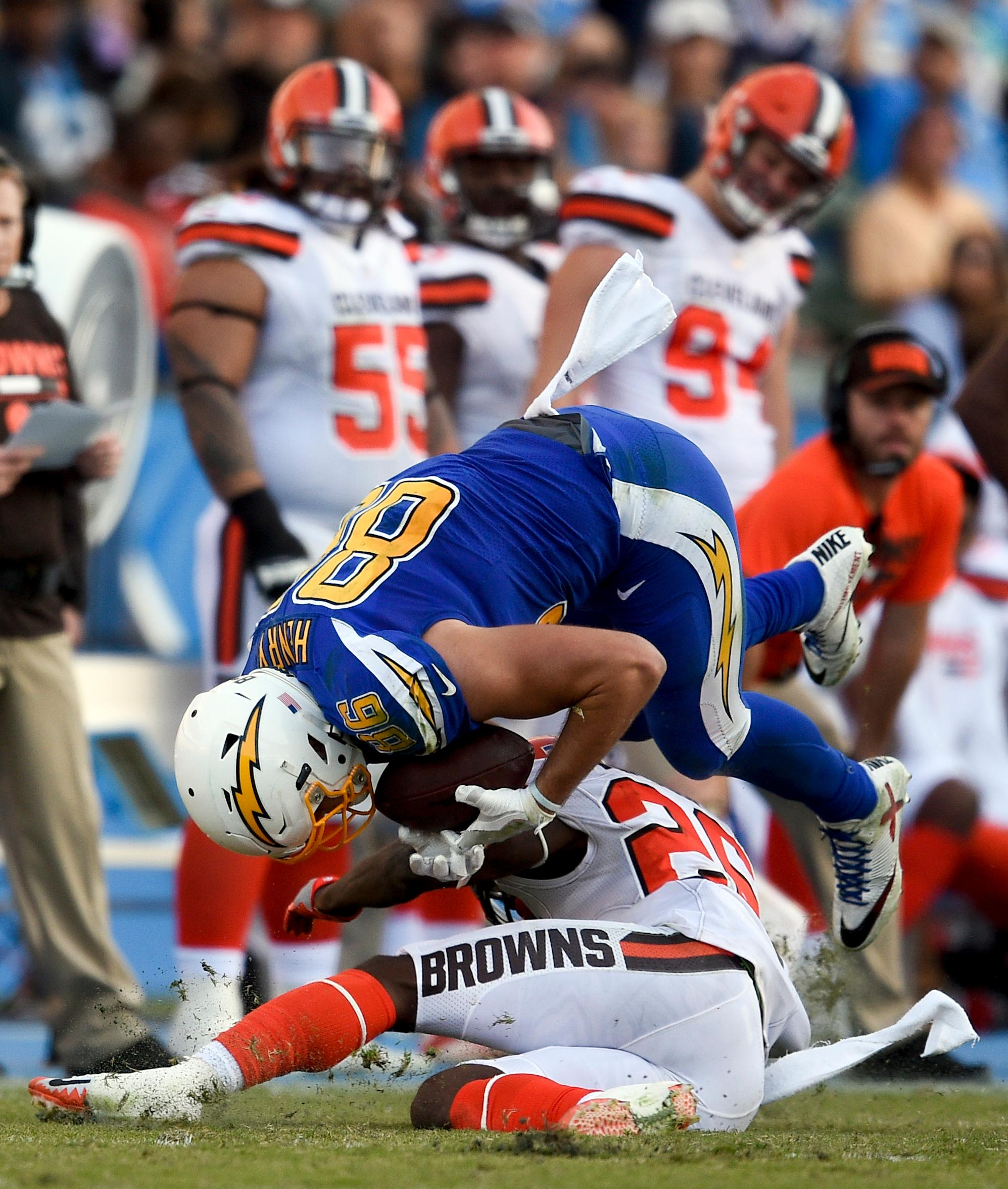 Los Angeles Chargers tight end Hunter Henry is tackled by Cleveland Browns strong safety Derrick Kindred during the second half of an NFL football game Sunday, Dec. 3, 2017, in Carson, Calif. (AP Photo/Kelvin Kuo)