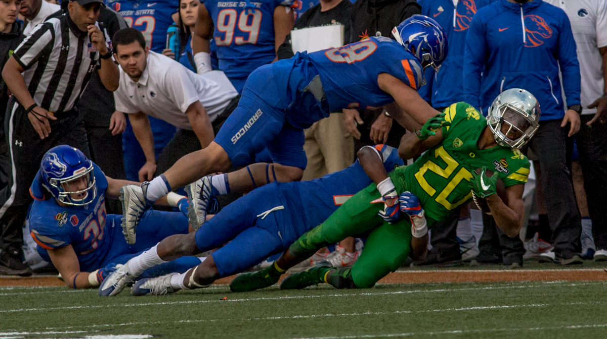 The Boise State defense brings down Oregon running back Tony Brooks-James (#20). The Boise State Broncos defeated the Oregon Ducks 38 to 28 in the 2017 Las Vegas Bowl at Sam Boyd Stadium in Las Vegas, Nevada on Saturday December 17, 2017. The Las Vegas Bowl served as the first test for Oregon's new Head Coach Mario Cristobal following the loss of former Head Coach Willie Taggart to Florida State University earlier this month. Photo by Ben Lonergan, Oregon News Lab