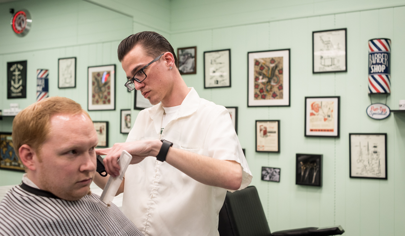 Dave Goodall works on a customer's haircut at Clifton Barbers. / Image: Melissa Doss Sliney // Published: 3.13.17