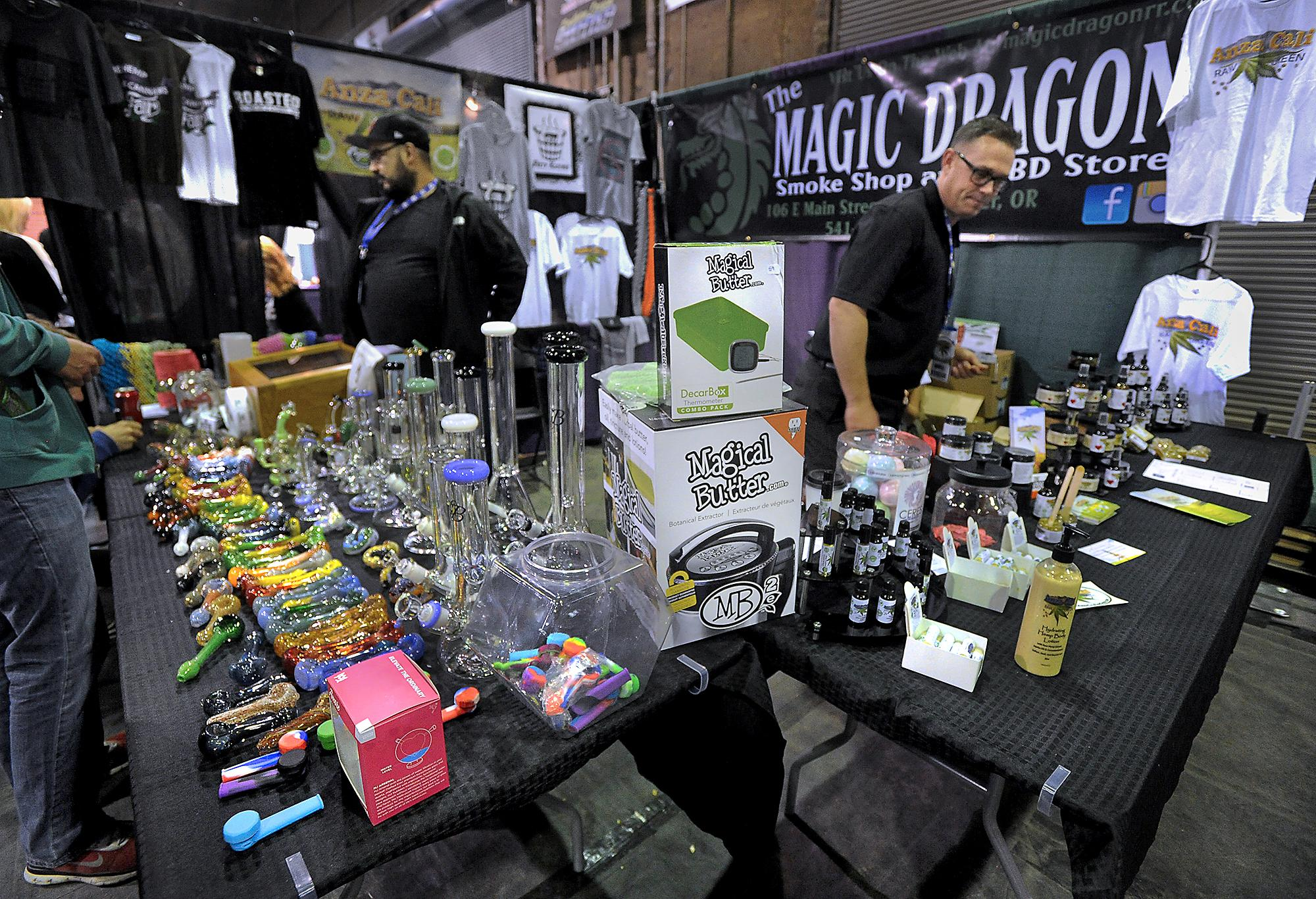 Photo by Denise Baratta <br><p>Merchants from the Magic Dragon in Rogue River sell smoking accessories on the left and CBD health and beauty products on the right Saturday during The Hemp and Cannabis Fair at the Expo in Central Point.</p>