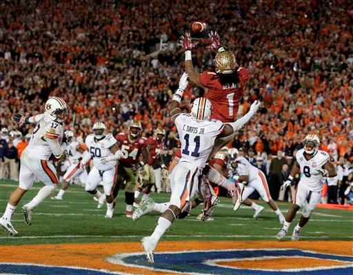 Florida State's Kelvin Benjamin catches the game-winning touchdown pass during the second half of the NCAA BCS National Championship college football game against Auburn Monday, Jan. 6, 2014, in Pasadena, Calif.