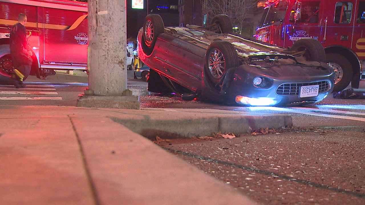 A 69-year-old man was rescued after being trapped in a car involved in a rollover crash in West Seattle Tuesday night, Jan. 2, 2018. (Photo: KOMO News)