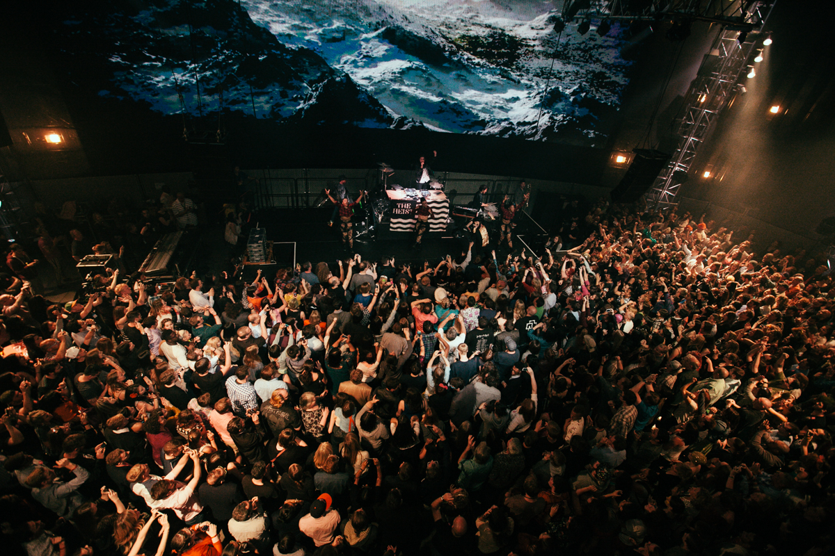 Macklemore and Ryan Lewis made a special appearance at EMP's Vivid event for the new exhibition Spectacle. The new exhibit is all about music videos so in the spirit Macklemore and Ryan Lewis performed their award winning Thrift Shop and Can't Hold Us to a screaming crowd. May 16th 2014. (Joshua Lewis / Seattle Refined)