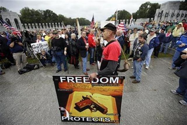 A protester speaks to people gathered at a rally at the World War II Memorial in Washington Sunday, Oct. 13, 2013.